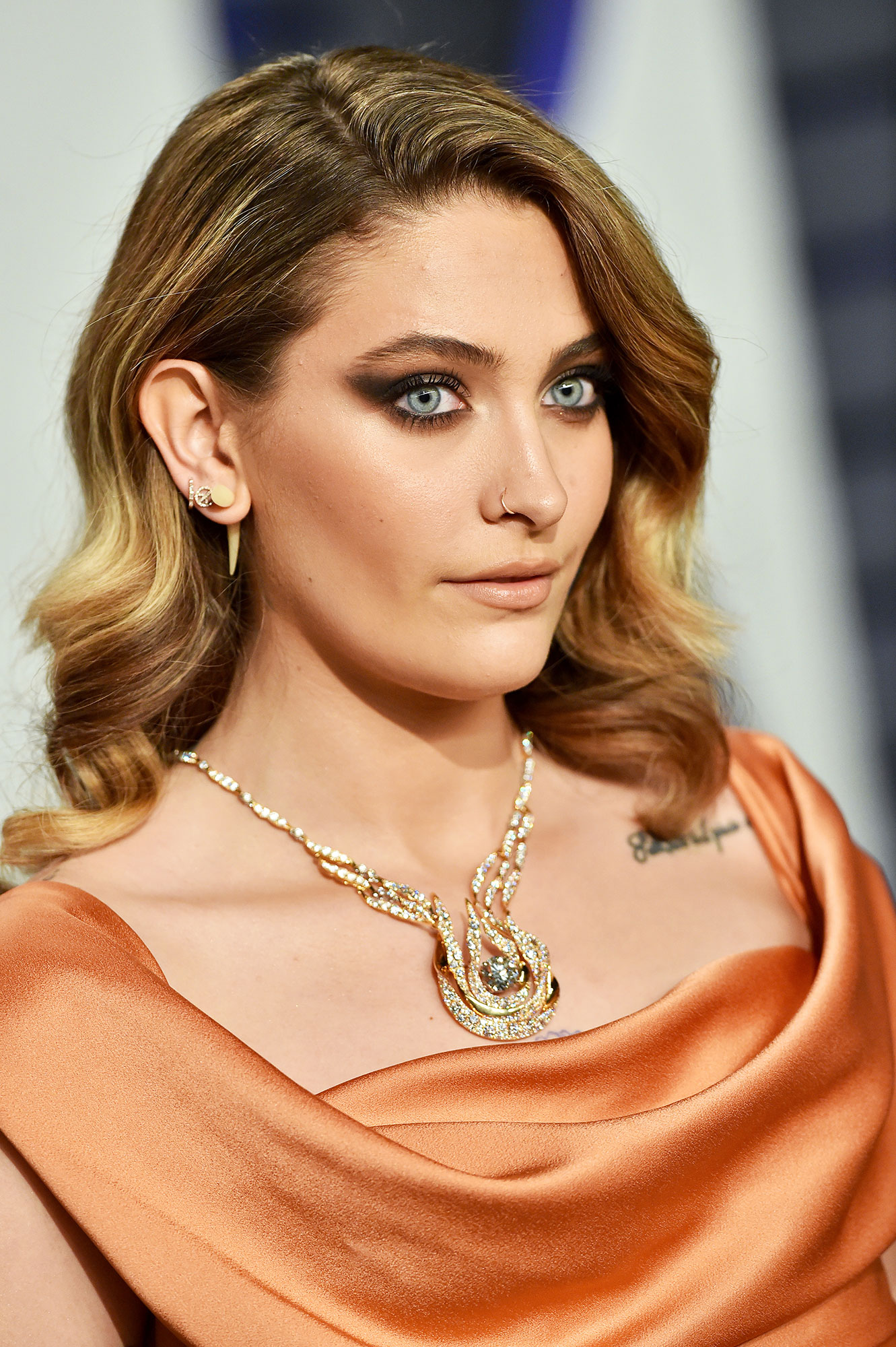 """Paris Jackson Celebs Are Here With All the Coachella Beauty Inspo You Need - Makeup artist Jo Baker used the black and rust shades in the limited-edition Charlotte Tilbury Icon eyeshadow palette to create this winged """"sooty smolder"""" look for the Coachella queen at the 2019 Vanity Fair Oscar Party."""