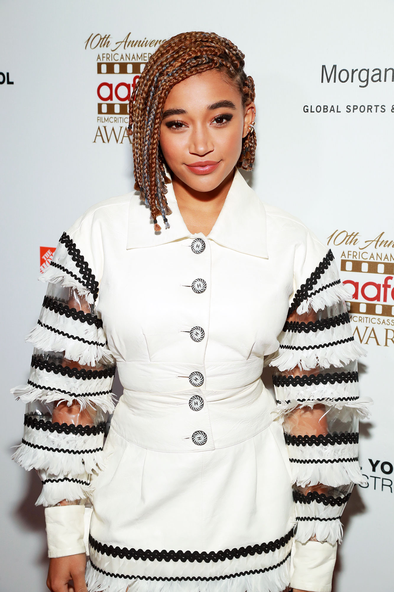 Amandla Stenberg Celebs Are Here With All the Coachella Beauty Inspo You Need - We're not sure what we love most about the actress' asymmetrical plaited 'do at the 2019 AAFCA Awards: the lob-length or the hints of the season's go-to icy purple hair color.
