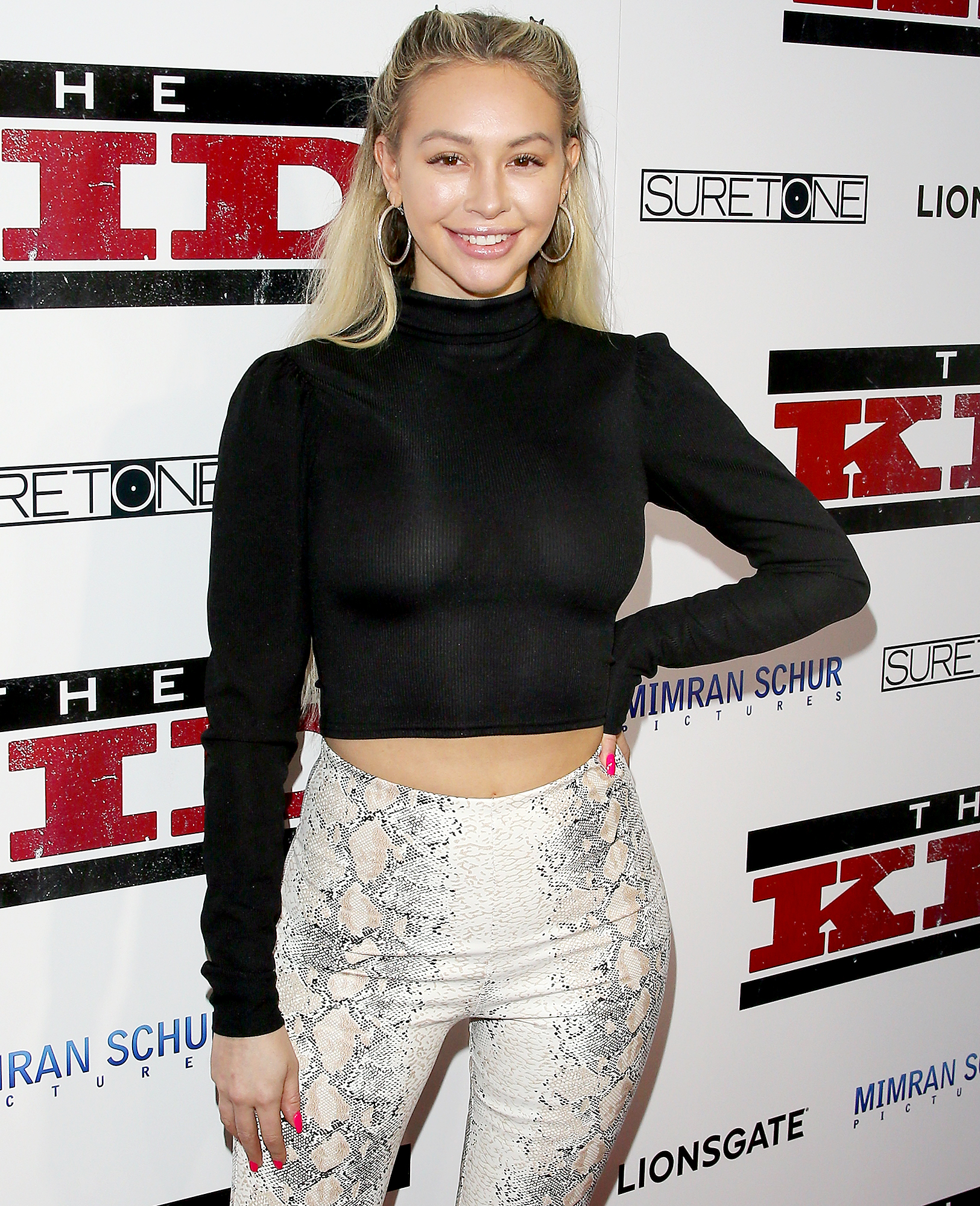 """Corinne-Olympios-Gonna-Get-Engaged-Jon-Yunger - Corinne Olympios attends the premiere of Lionsgate's """"The Kid"""" at ArcLight Hollywood on March 06, 2019 in Los Angeles, California."""