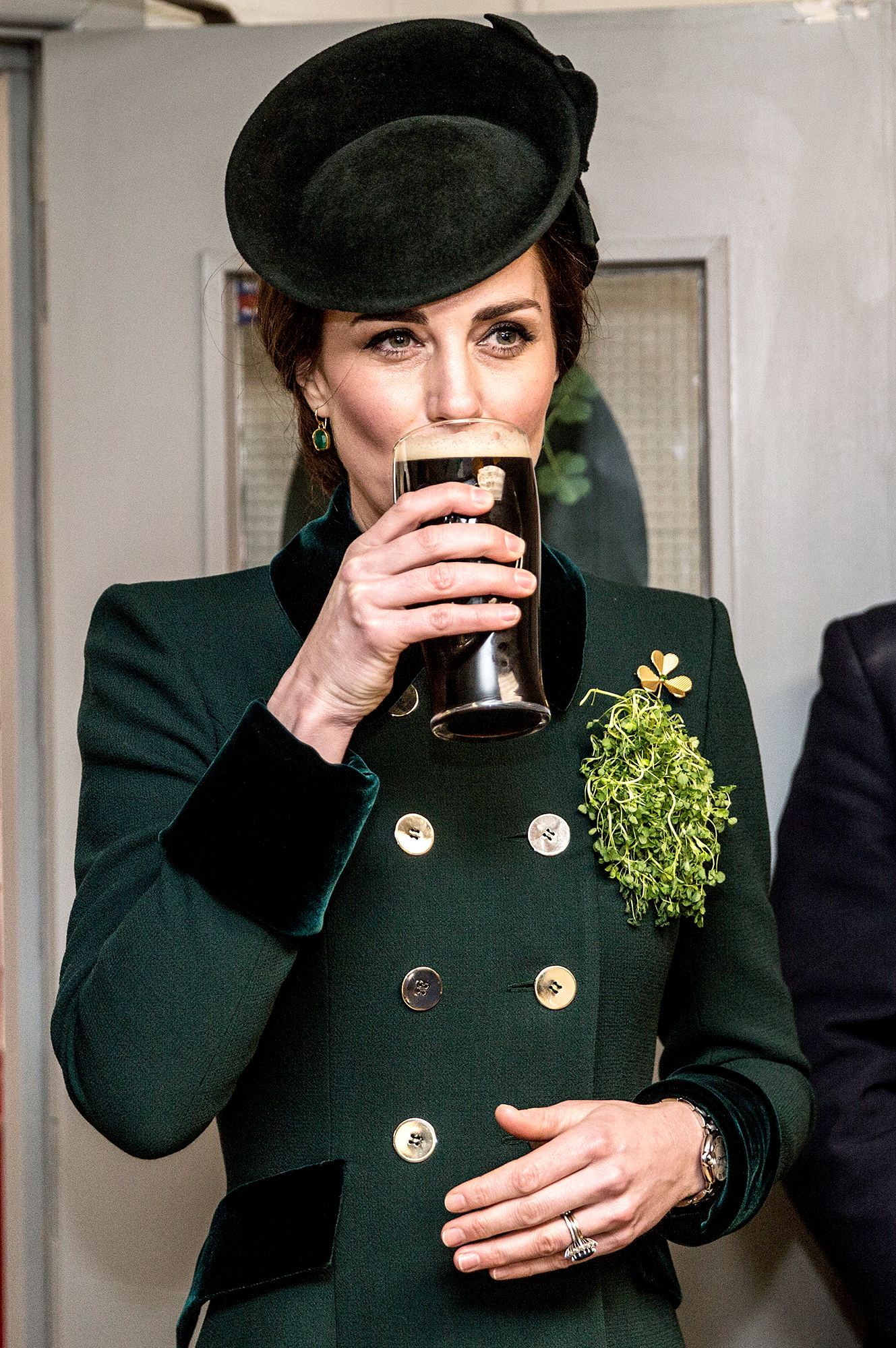 Dressed-in-Green-and-Drinking-a-Guinness--duchess-kate - She may not be Irish, but Kate certainly knows how to look and dress the part. In March 2017, the royal took a drink of Guinness as she met with soldiers of the first battalion Irish Guards in their canteen following their St. Patrick's day parade at Cavalry Barracks in London.