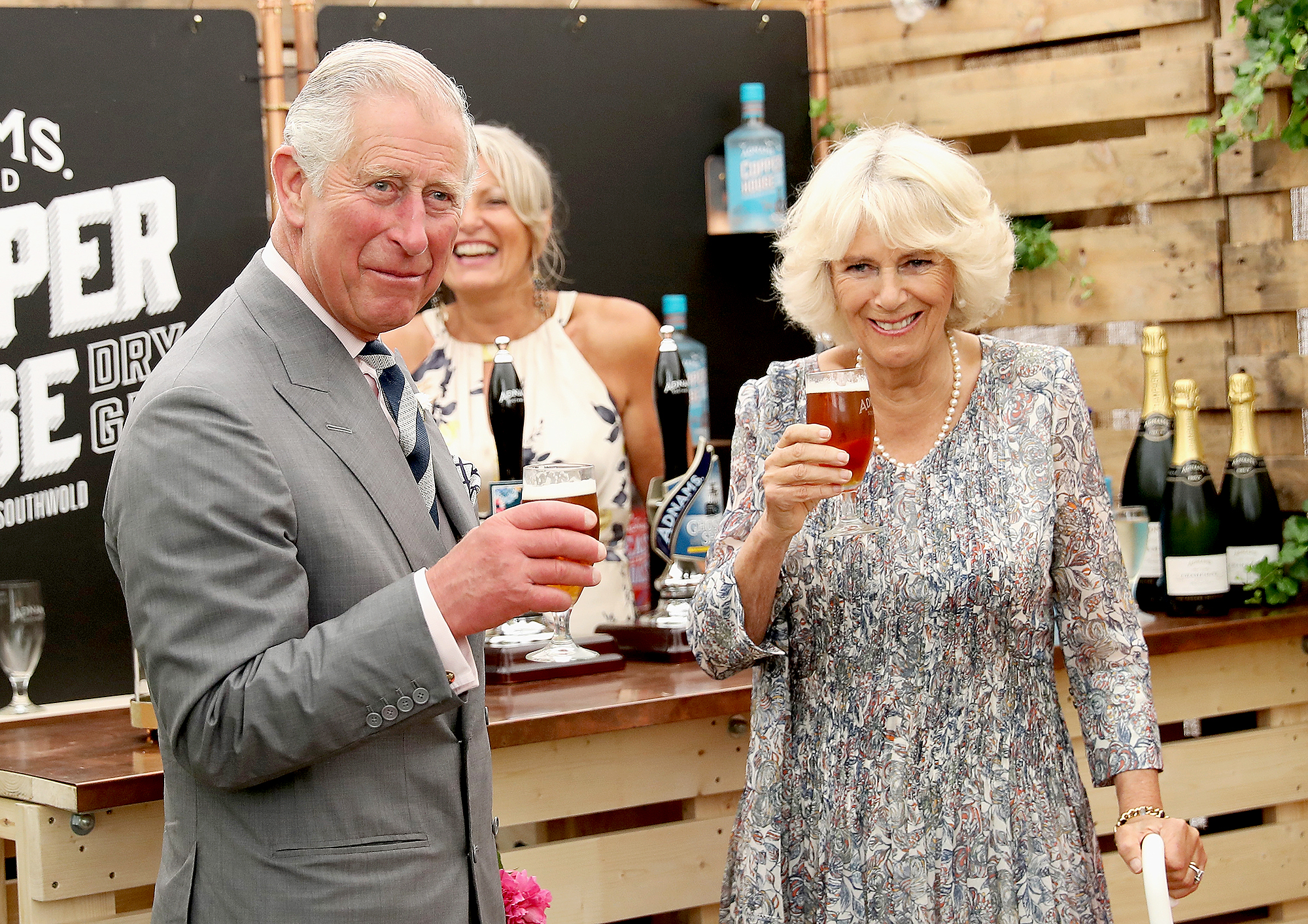 Drinking-Duo-prince-charles-camila-beer - Camilla , Duchess of Cornwall and Prince Charles drank beers side-by-side as they visited the Sandringham Flower Show in Sandringham, England, on July 27, 2016. Cheers, you two!