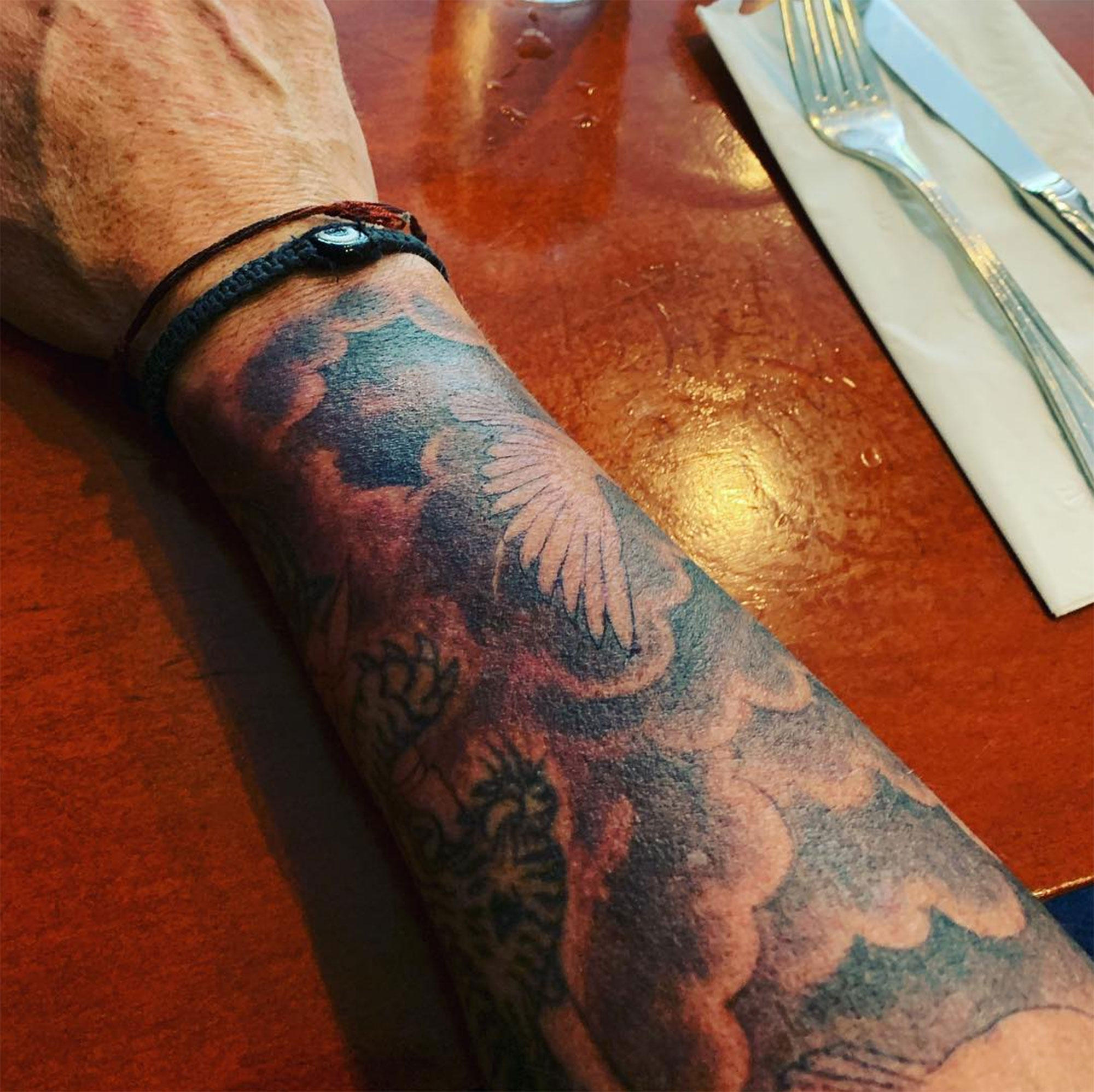 """Dylan McDermott's New Huge Tattoo Leads Our List of Crazy Celeb Ink - Only days after news broke that he and fiancée Maggie Q split, the actor took to Instagram on March 3, 2019, to show off his new """"half sleeve"""" by Hollywood tattoo artist Mark Mahoney."""
