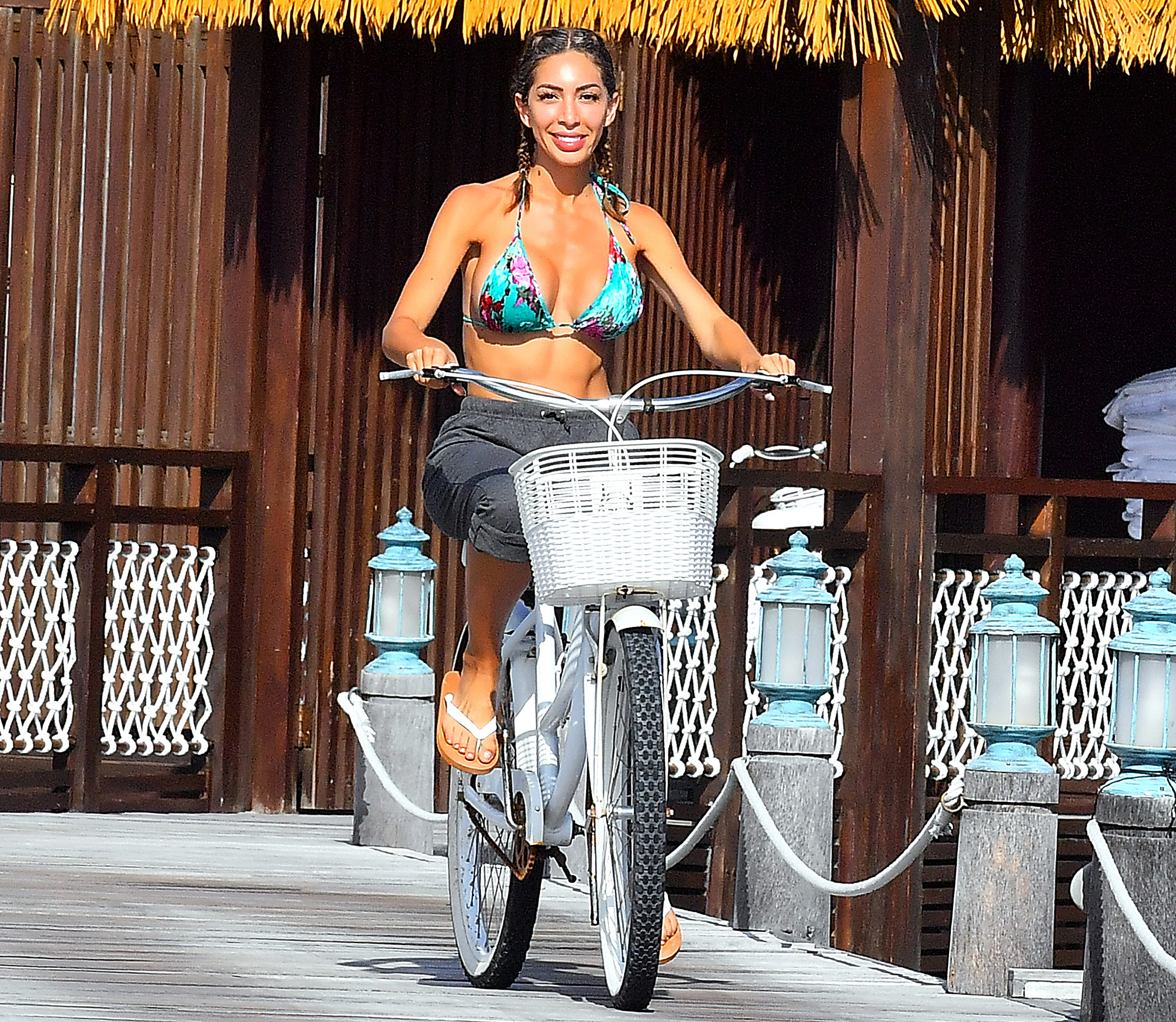 Farrah-Abraham-biking - In the Maldives on November 15, 2018, the former Teen Mom OG star — who has taken up boxing as her main fitness activity — pedaled near the sea in a bikini.