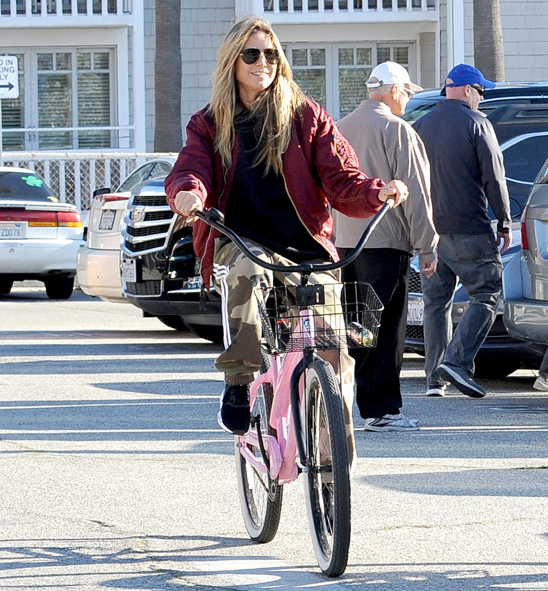"Heidi-Klum-biking - Sure, the model (cruising along a boardwalk in Santa Monica, California on December 29, 2018) works out — but she thinks just staying active is the most important thing. ""Most of the time, when I'm looking around at some of my friends at the gym, they're pumping weights and running I don't know how many miles. They run so fast and so hard. You know, they always have something wrong with their back or their knees hurt. So I think sometimes we shouldn't overdo it so much,"" she told Us in July 2018."