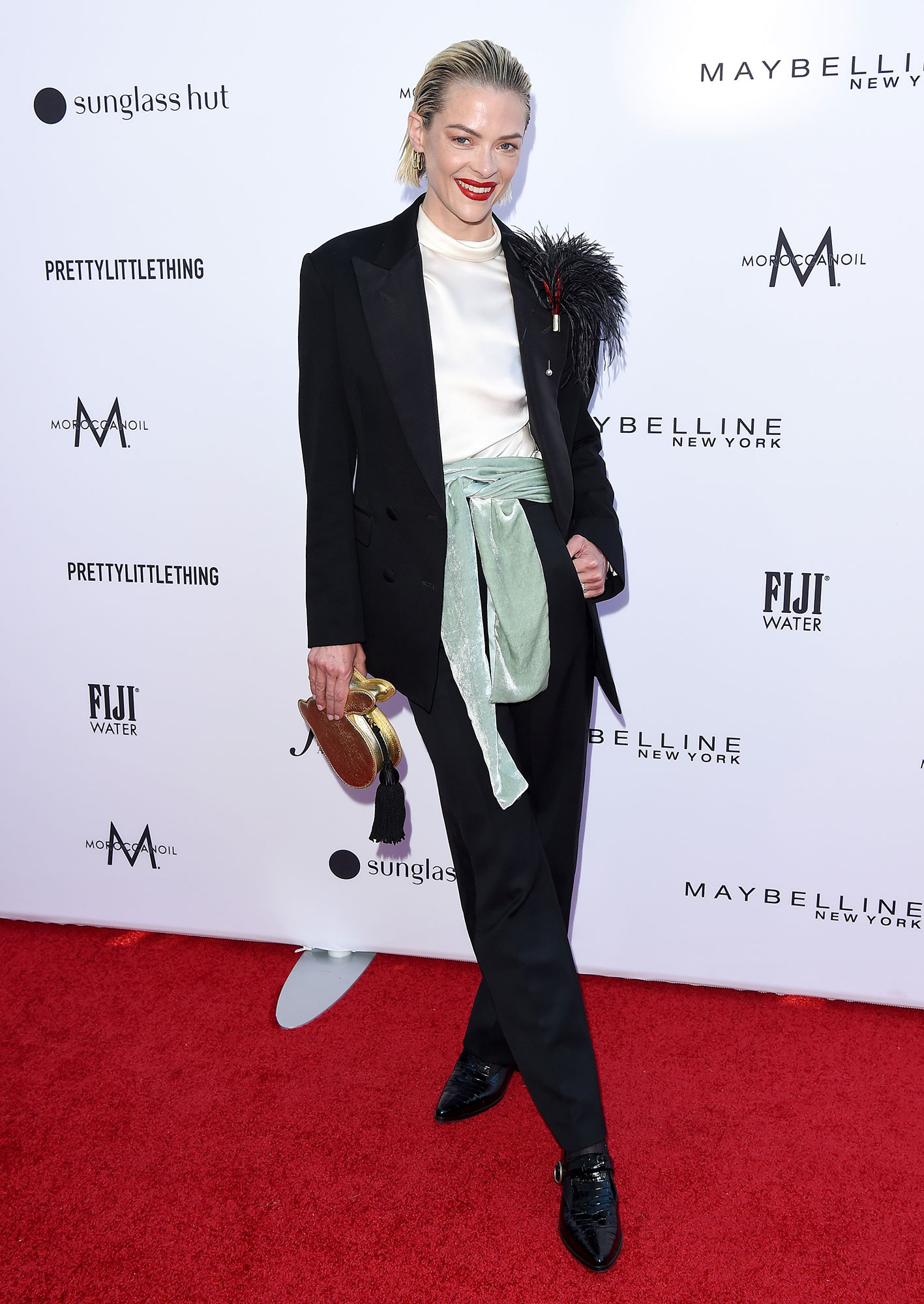Stars Brought Their Style A-Game to the Daily Front Row Fashion Awards - In a tailored suit, the actress added a funky appeal to her otherwise simple look with a green scarf around the waist and an ostrich feather attached to the lapel.
