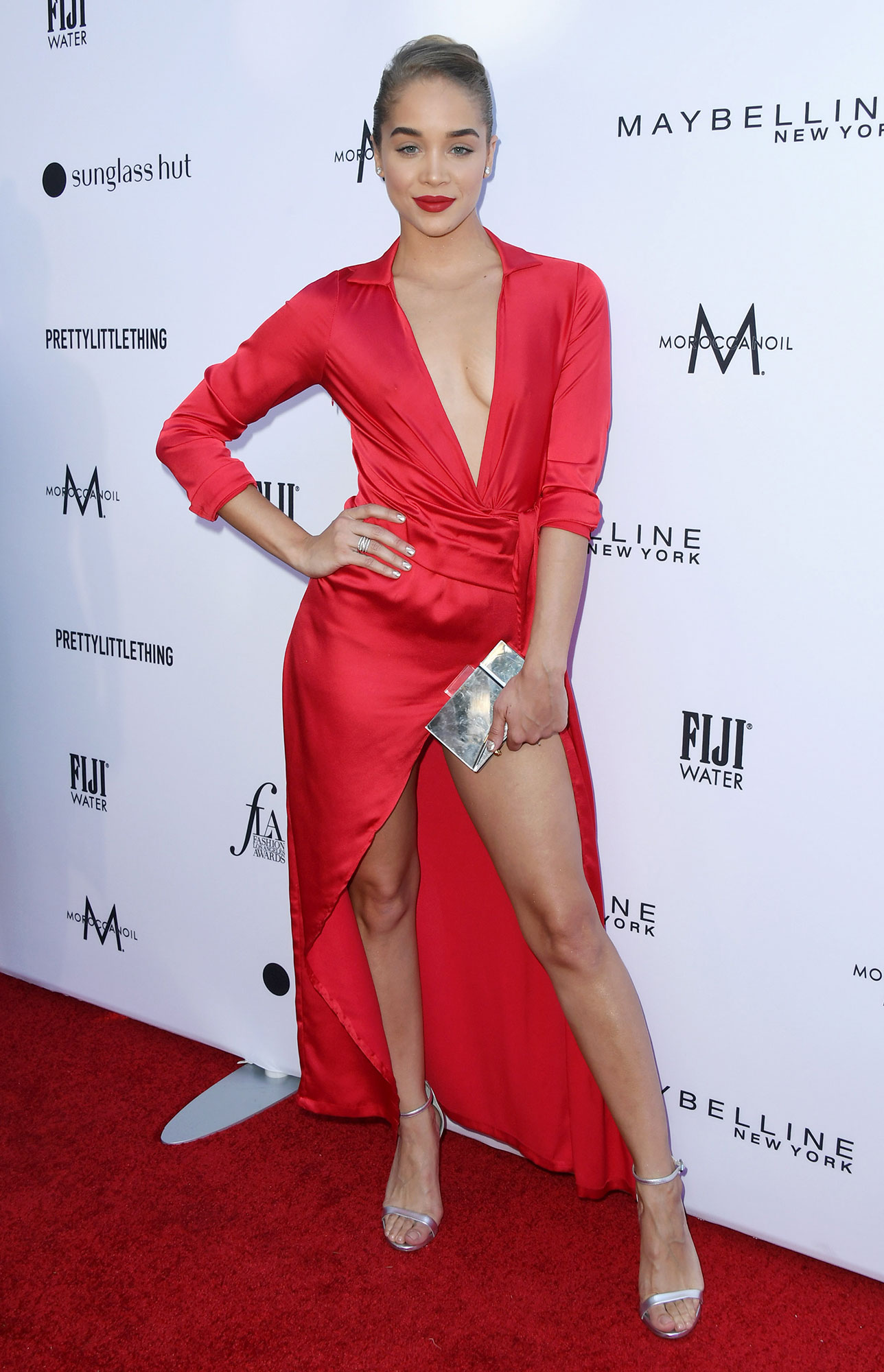 Stars Brought Their Style A-Game to the Daily Front Row Fashion Awards - Matching her lip to her dress, the model rocked a dangerously high leg slit and a bold shiny hue.