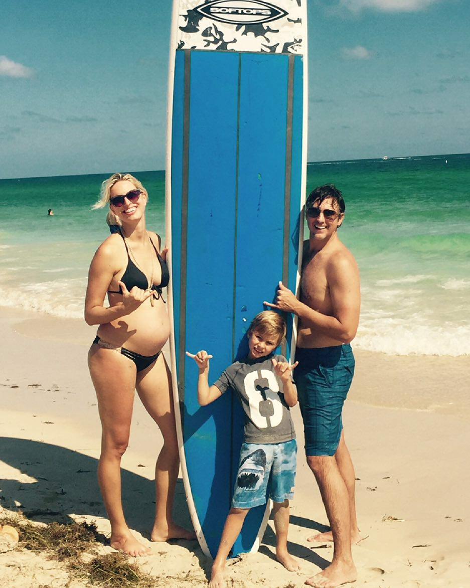 "Jessica Simpson and More Pregnant Celebs Showing Off Third Trimester Baby Bumps in Bikinis - The supermodel enjoyed a ""family surfing day"" in a black bikini one month before her son's arrival."