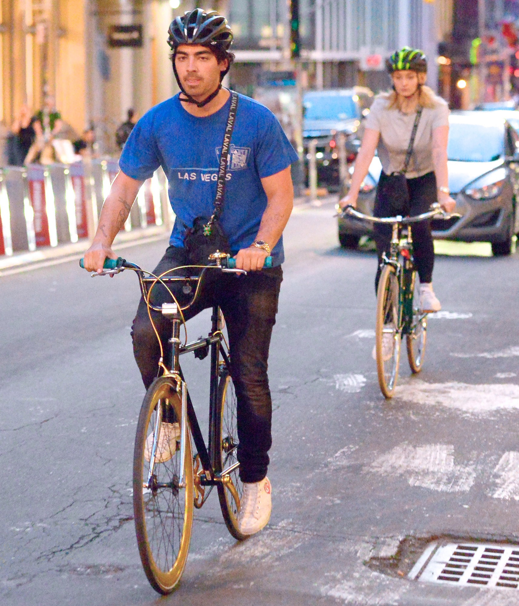 Joe-Jonas-Sophie-Turner-biking - The engaged couple went for a Citi Bike ride through Manhattan on July 20, 2018 — and very responsibly wore helmets.