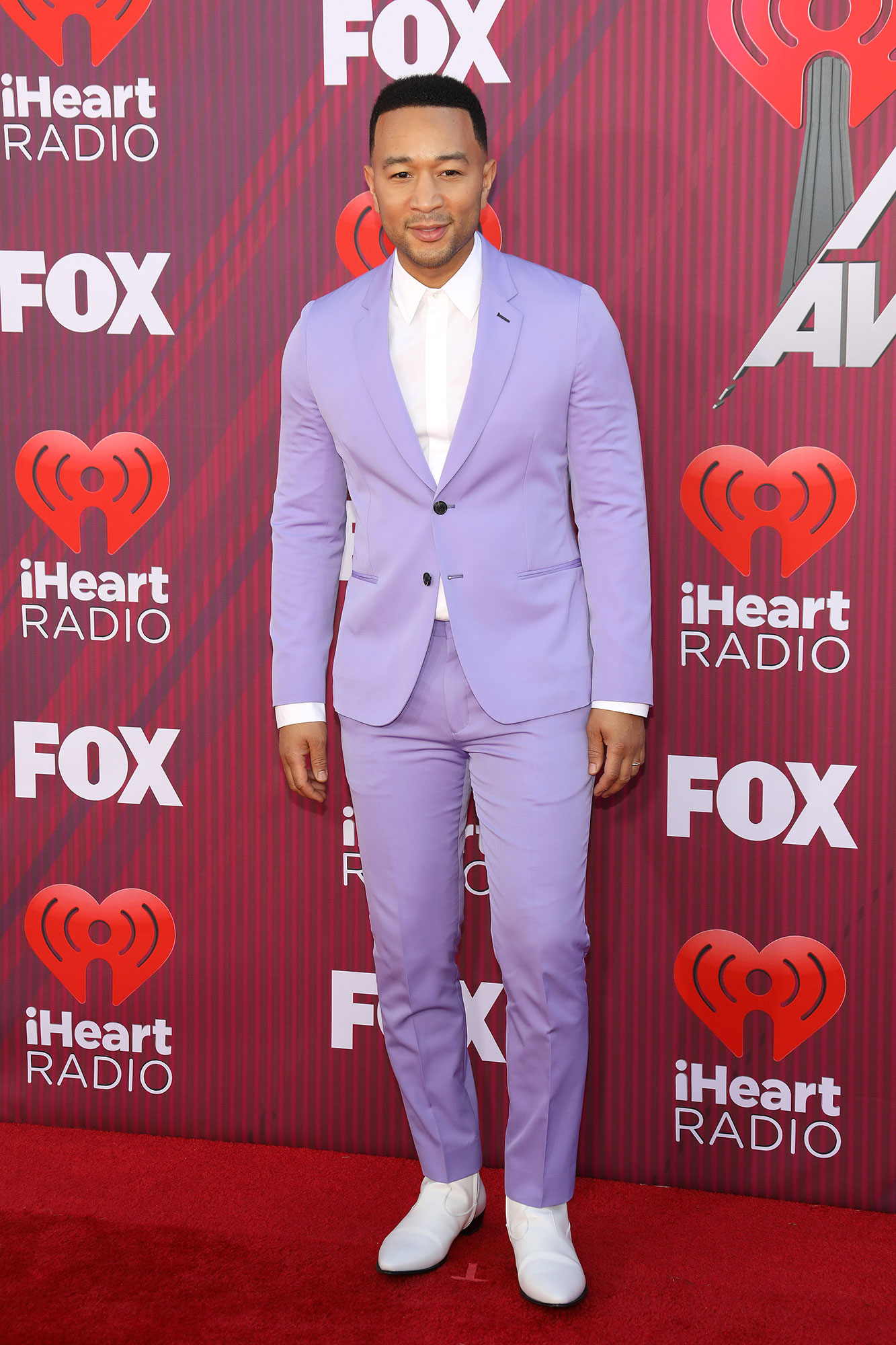 John Legend on College Scam - John Legend arrives at the 2019 iHeartRadio Music Awards which broadcasted live on FOX at Microsoft Theater on March 14, 2019 in Los Angeles, California.