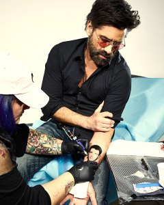John Stamos Ups His Prank War With Nick Jonas By Tattooing His Face On His Arm