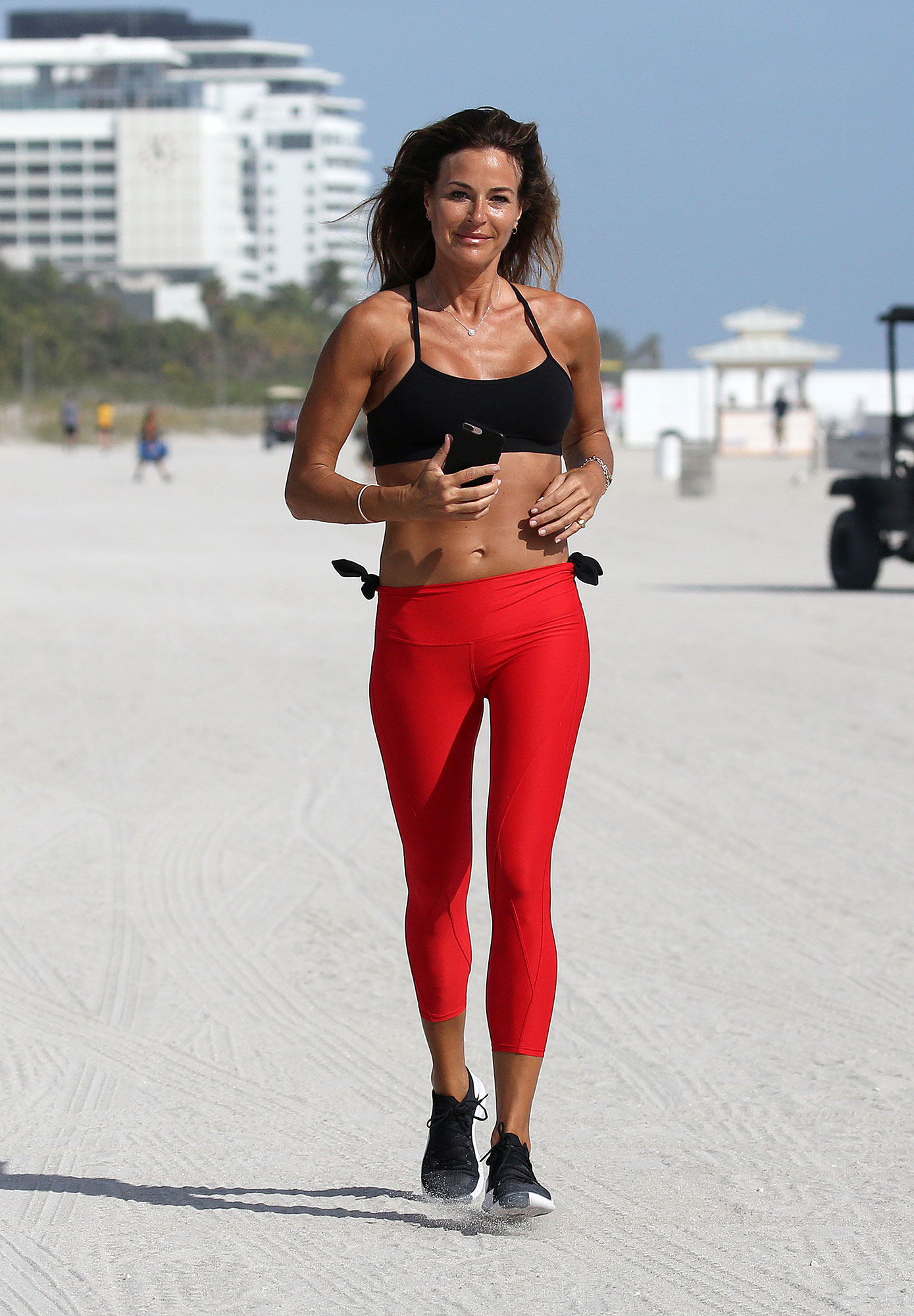 Kelly Bensimon Celebrity Joggers - Have red pants, will sweat. The tanned Real Housewives of New York City star put in a beachside workout in Miami on January 3, 2019.