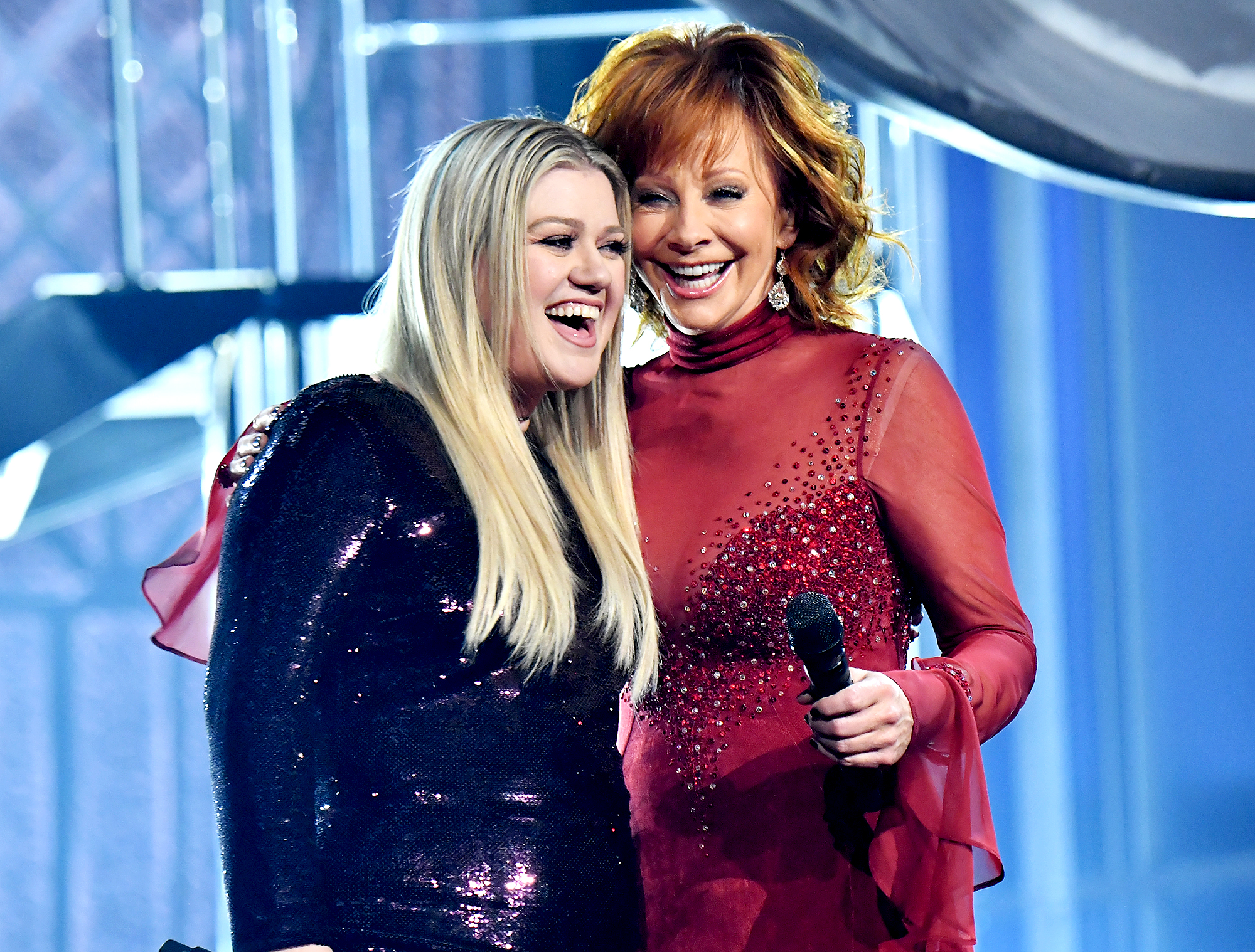 "Kelly-Clarkson-and-Reba-McEntire - Clarkson, who is married to McEntire's former stepson Brandon Blackstock , paid tribute to the country music icon at the 2018 Kennedy Center Honors. ""Sometimes when we meet our heroes, it doesn't always pan out how you hope. But meeting Reba — being friends with her, and eventually becoming family — has been one of the highlights of my life, truly,"" the American Idol alum raved in December 2018."