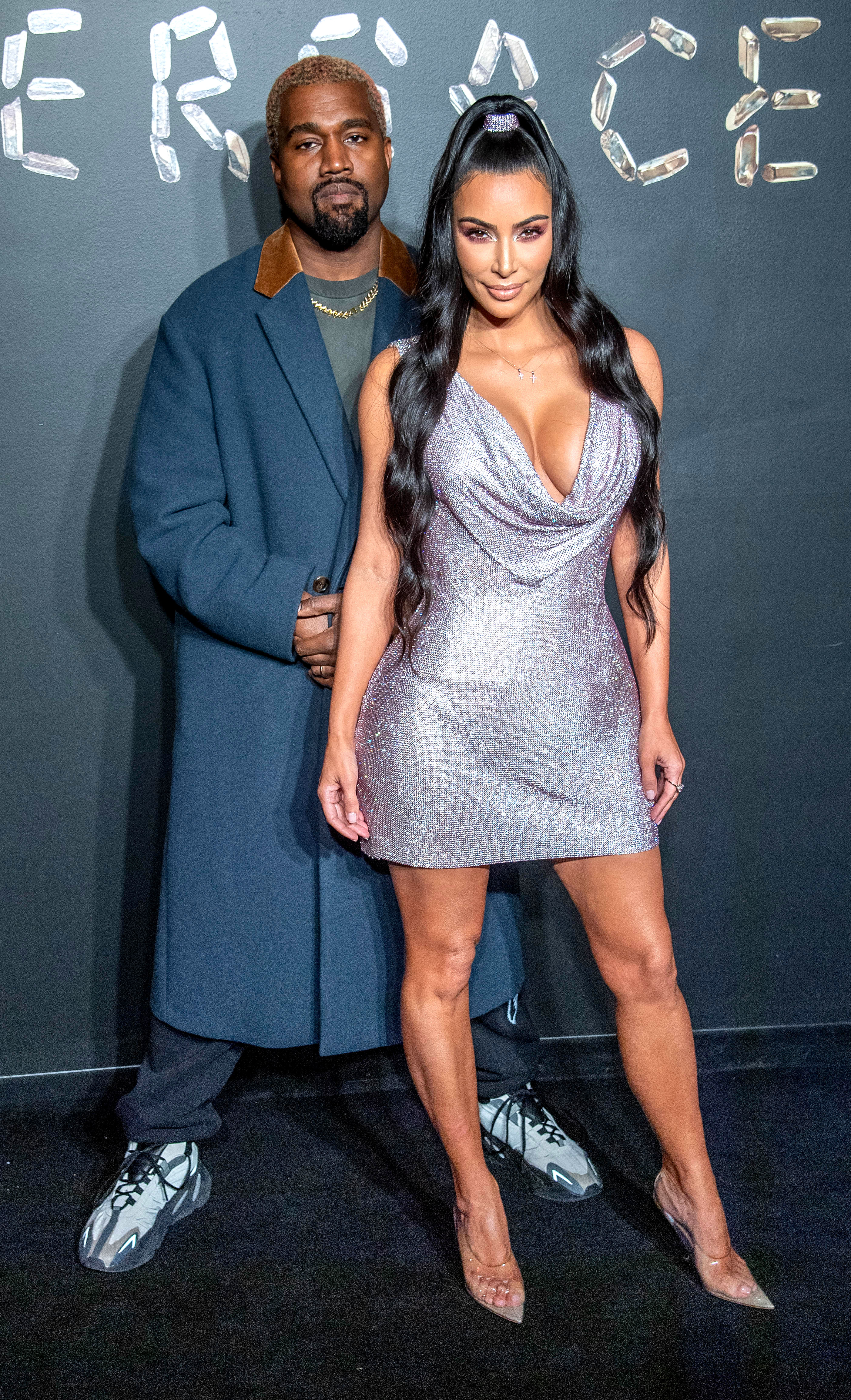 Kim Kardashian and Kanye West Welcome Their Fourth Child Via Surrogate - Kanye West and Kim Kardashian West attend the the Versace fall 2019 fashion show at the American Stock Exchange Building in lower Manhattan on December 02, 2018 in New York City.