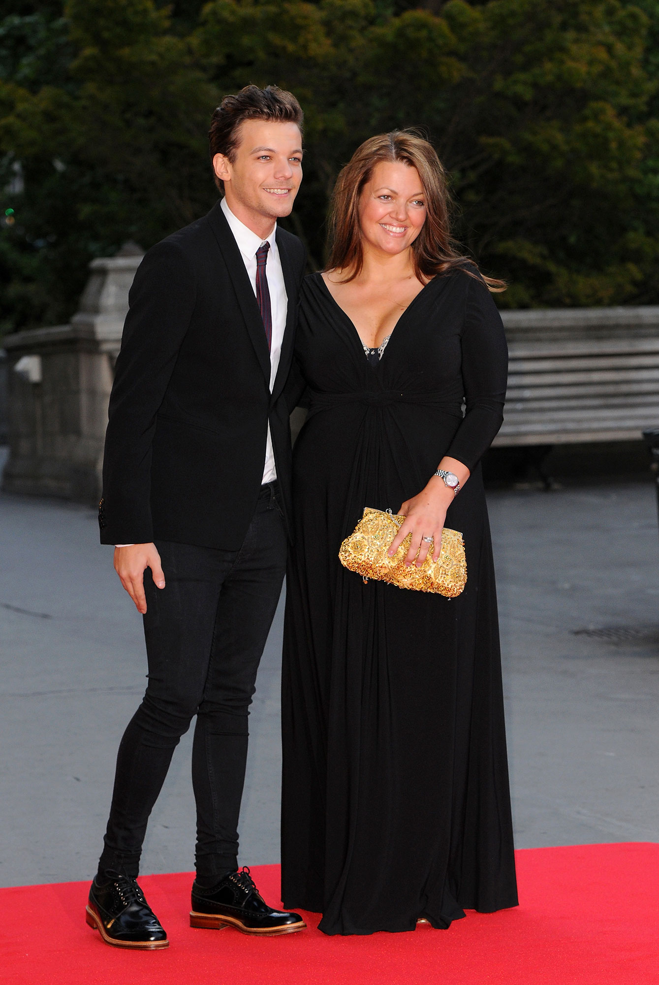 Louis Tomlinson Speaks Out for the First Time Following His Sister's Death - Louis Tomlinson and Mother Johannah Deakin attend the Believe in Magic Cinderella Ball at Natural History Museum on August 10, 2015 in London, England.