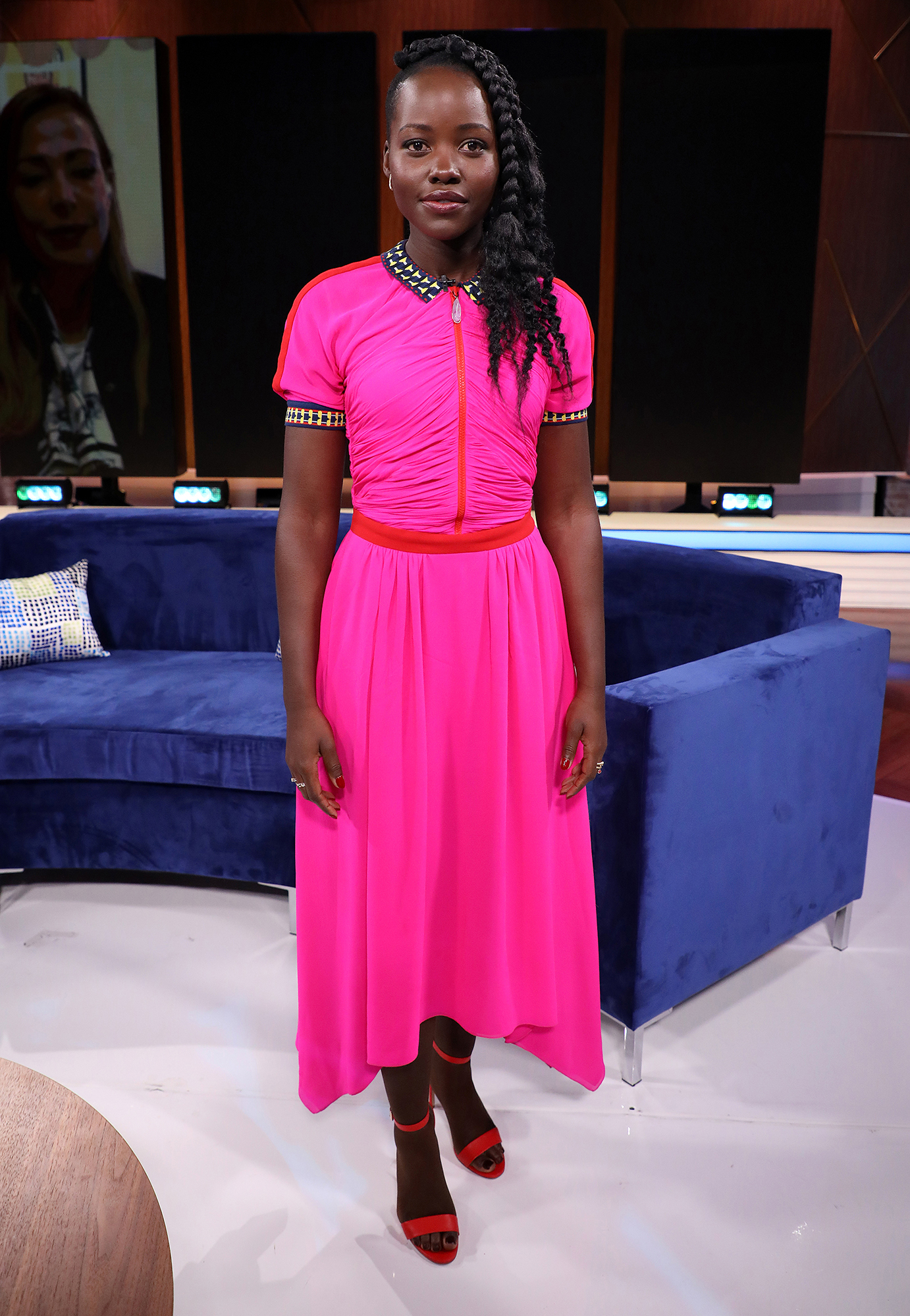 Lupita Nyong'o Can't Stop Wearing These $60 Sandals - Lupita Nyong'o is seen on the set of 'Un Nuevo Dia' at Telemundo Center to promote the film 'Us' on March 21, 2019 in Miami, Florida.