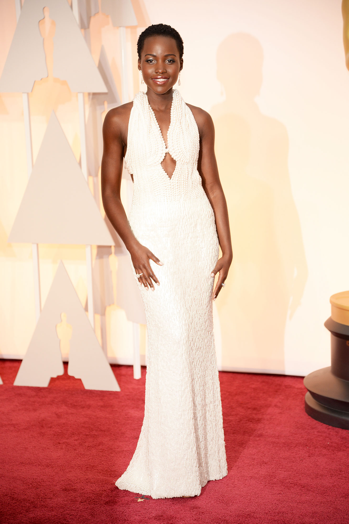 Lupita Nyong'o Celeb-Fave Calvin Klein Is Shutting Down Its Runway and Collection Businesses - Actress Lupita Nyong'o arrives in Chopard to the 87th Annual Academy Awards at Hollywood