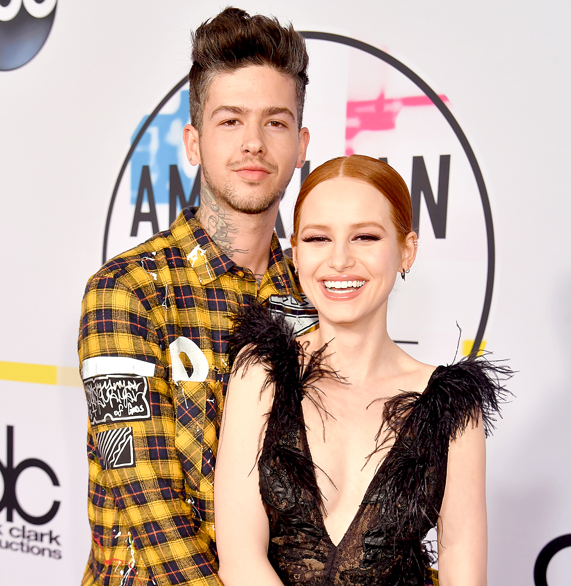 Madelaine-Petsch-and-Travis-Mills - The actress linked up with the rapper after he congratulated her on the success of Riverdale via Facebook the same month the show premiered on The CW. Now, the couple are incredibly open about their romance on the internet.