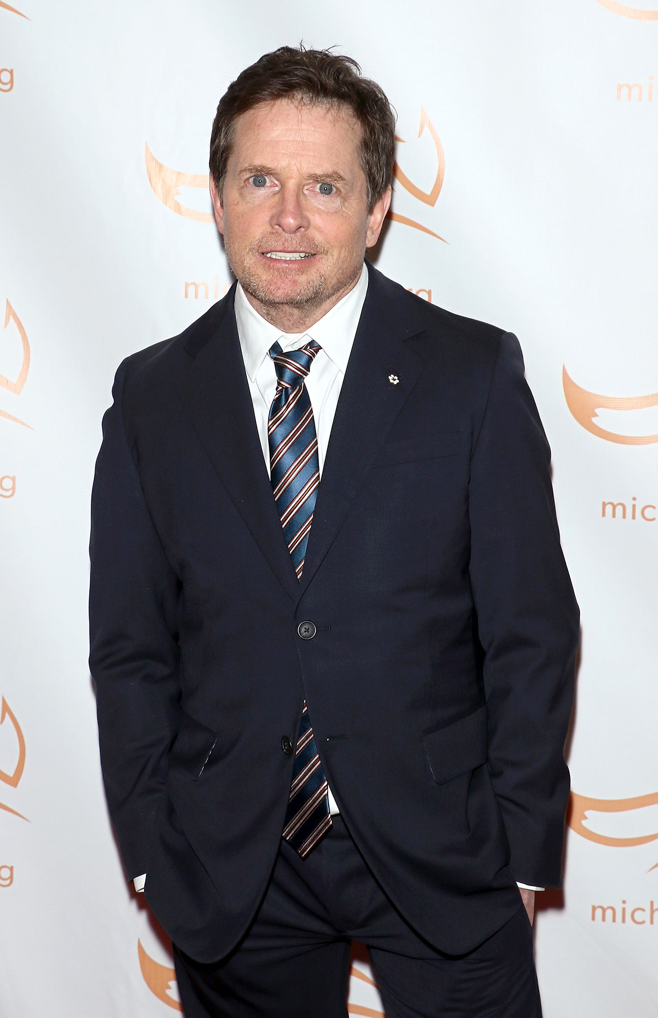 "Celebrity Health Scares - Michael J. Fox - The Designated Survivor star, who has been battling Parkinson's for years — he was diagnosed with the disease in 1991 — revealed to the New York Times in February 2019 that he has also been suffering from problems with his spinal cord. ""I was told it was benign but if it stayed static I would have diminished feeling in my legs and difficulty moving. Then all of a sudden I started falling — a lot,"" he explained."