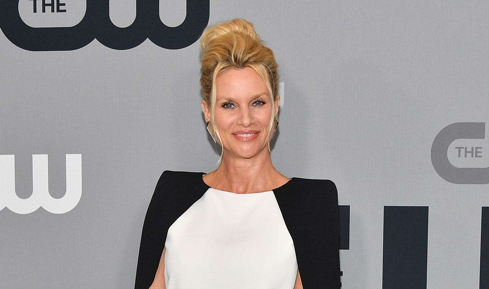 Nicollette Sheridan: What's in My Bag? - Nicollette Sheridan attends the 2018 CW Network Upfront at The London Hotel on May 17, 2018 in New York City.