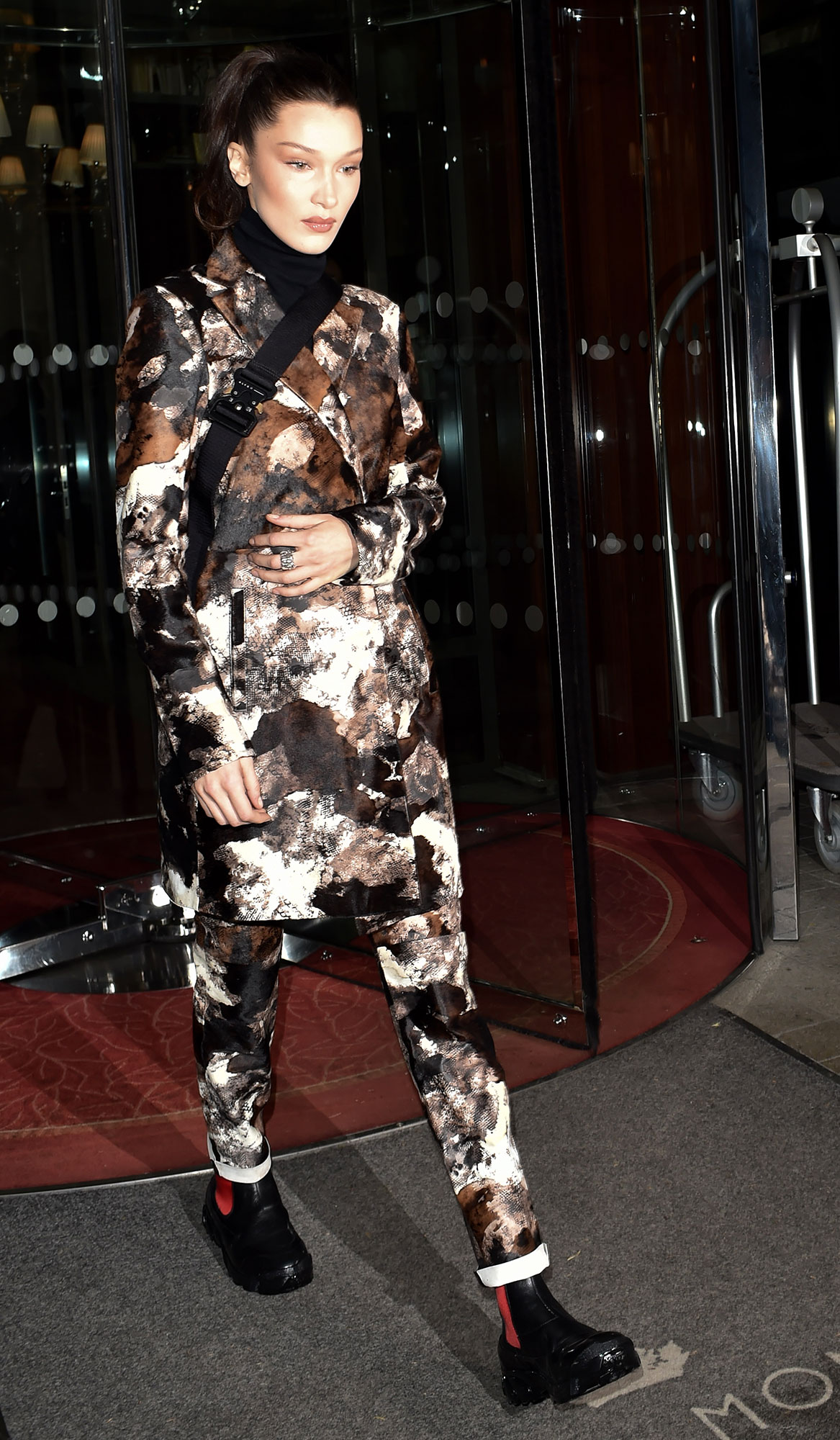 Bella Hadid Stars Continue to Wow on Day 9 of Paris Fashion Week - The brunette beauty rocked an urban camouflage look in her monochrome two-piece on Monday, March 4.