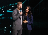 Prince Harry Surprises Crowd and Drags Pregnant Wife Duchess Meghan on Stage at Charity Event
