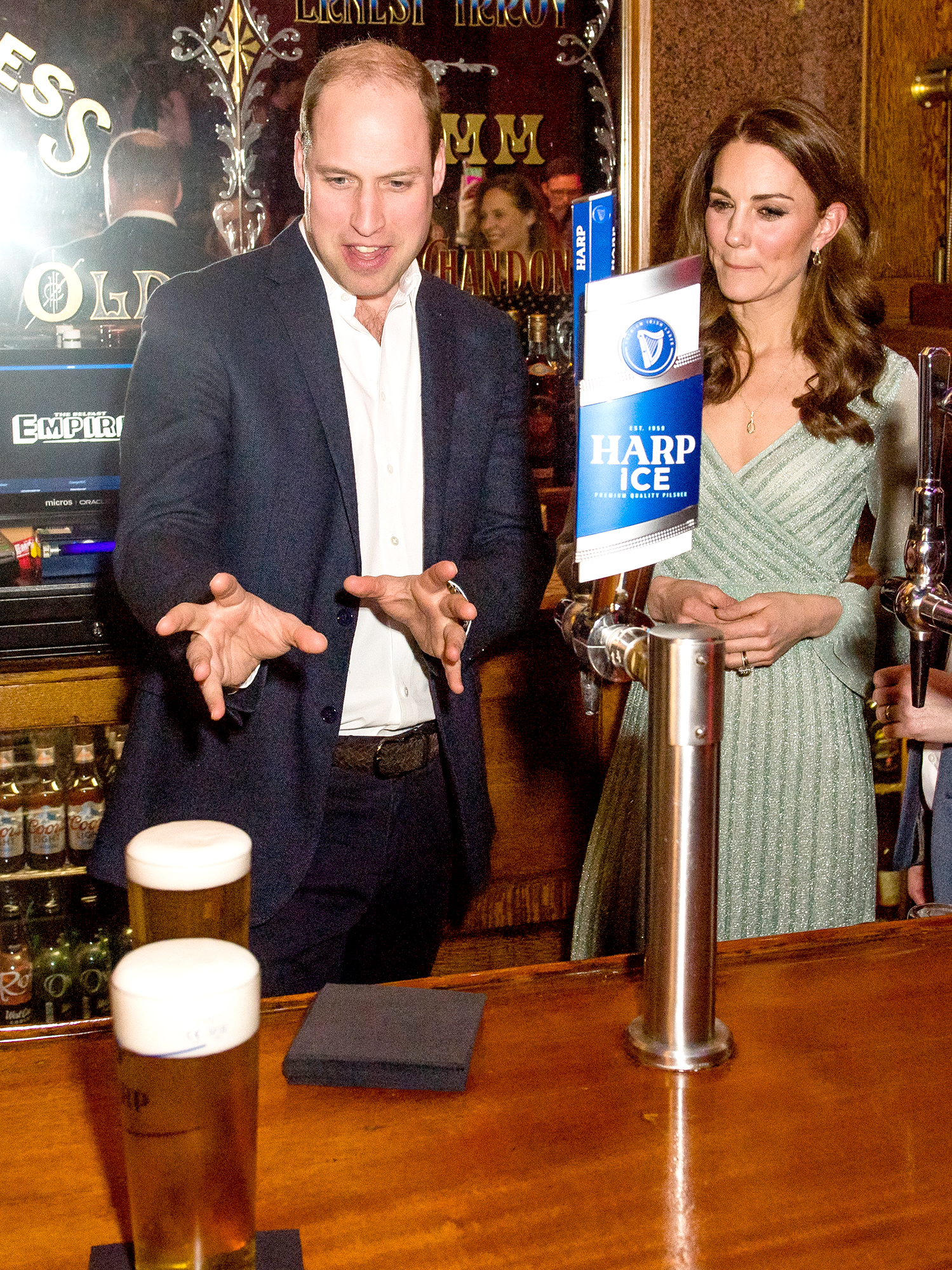 Putting-a-Spell-on-Some-Beer-duchess-kate-prince-william-beer - Meanwhile, Prince William stepped behind the bar and appeared to put a spell on a pair of beers resting on the bar while his wife looked on during that same February 2019 trip to Belfast.