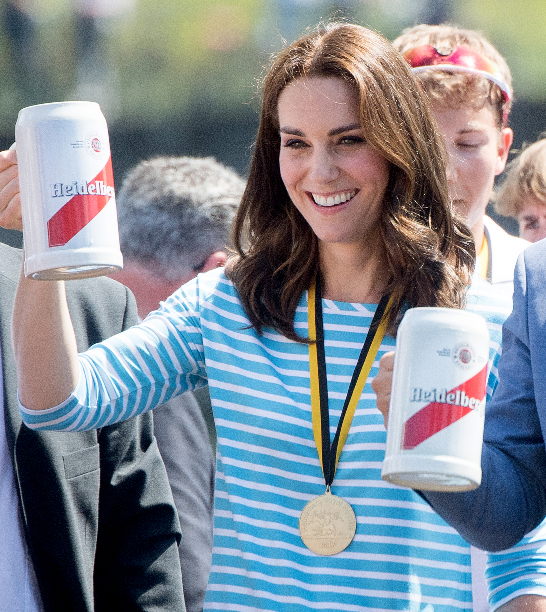 Raising-a-Glass-duchess-kate - The royal celebrated her victory by raising a glass full of beer in Heidelberg, Germany, after participating in a rowing race between the twinned town of Cambridge and Heidelberg during an official visit to Poland and Germany in July 2017.