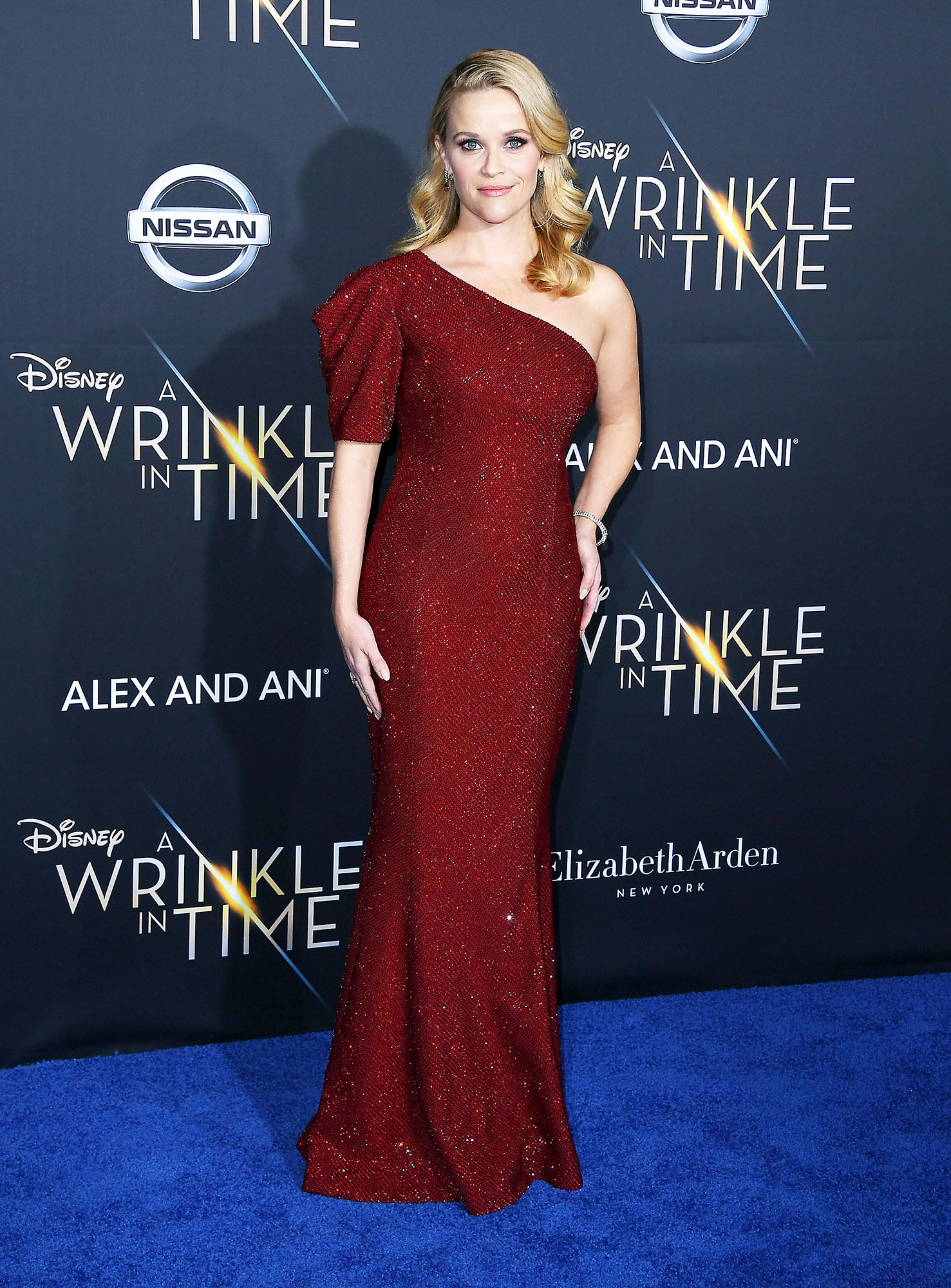 Birthday Girl Reese Witherspoon's Best Red Carpet Looks - The actress stunned at the A Wrinkle in Time premiere on February 26, 2018, wearing a deep red Michael Kors one-shouldered gown with sparkly sequins.