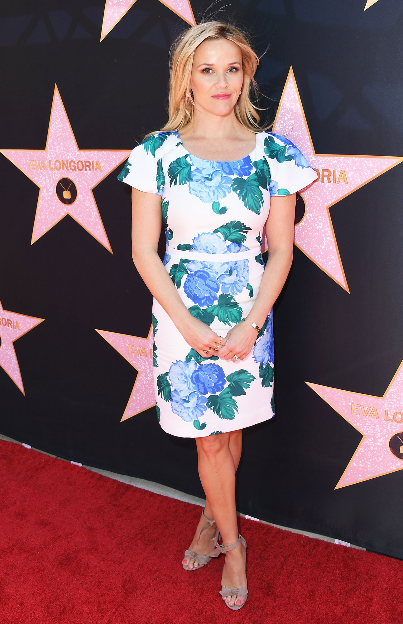 Birthday Girl Reese Witherspoon's Best Red Carpet Looks - To celebrate Eva Longoria's Hollywood Star on April 16, 2018, the Legally Blonde actress looked like a spring dream in a floral print dress from her very-own Draper James.