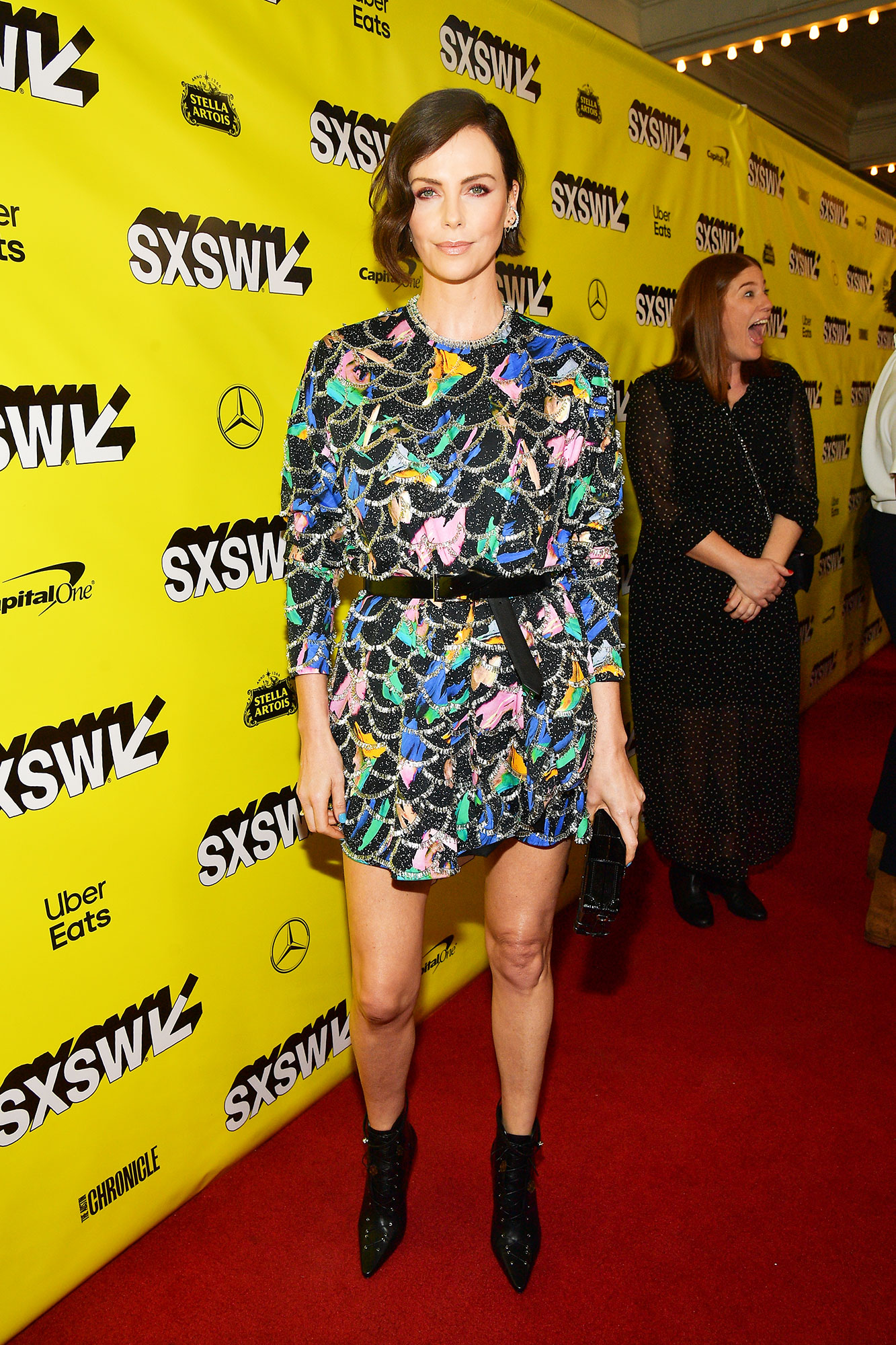 Charlize Theron SXSW Is Giving Us Chic Outfit Inspo for Spring - The newly brunette beauty kept things short and sweet in a printed Louis Vuitton mini at the Long Shot screening on Saturday, March 9.