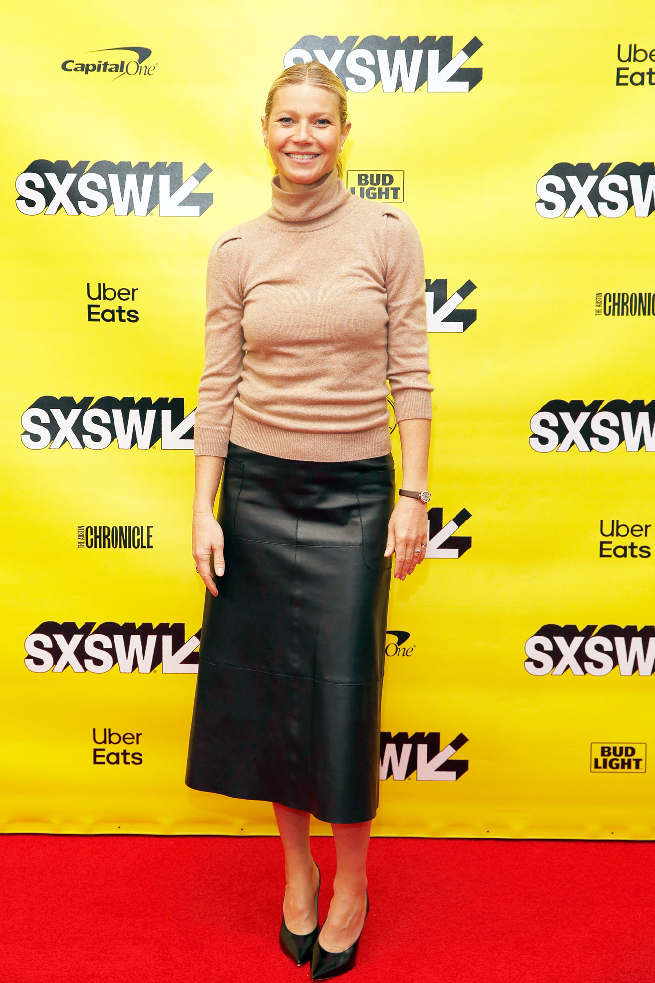 Gwyneth Paltrow SXSW Is Giving Us Chic Outfit Inspo for Spring - It was all about the chic separates for the Goop founder on Monday, March 11, in an oatmeal-colored turtleneck sweater and black leather skirt.