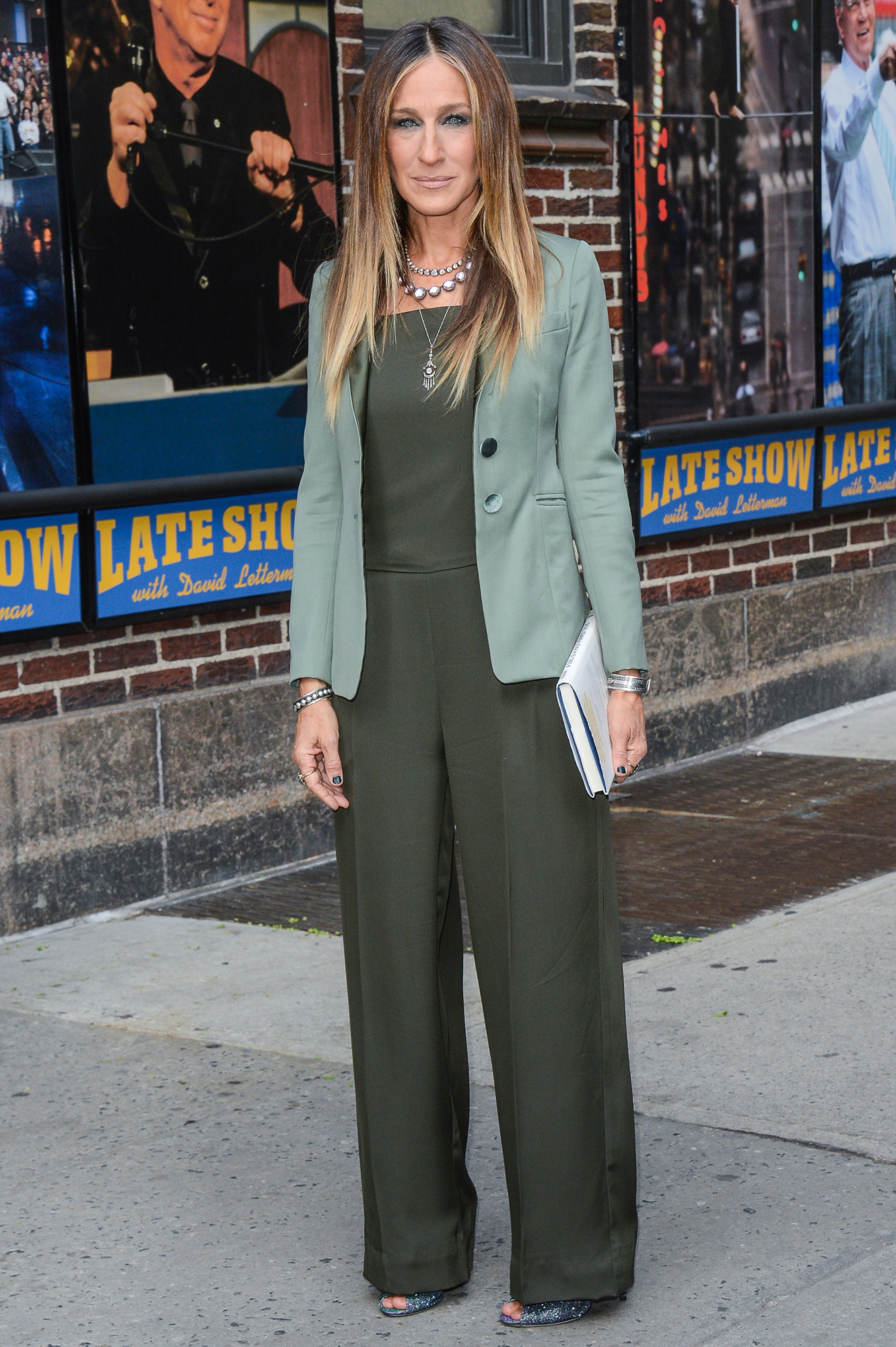 Happy Birthday, Sarah Jessica Parker! See Her Red Carpet Style Evolution - The footwear designer stopped by the Late Show With David Letterman in April 2015 in an olive green Theory jumpsuit that she accessorized with a mint blazer, sparkly shoes and layered necklaces.