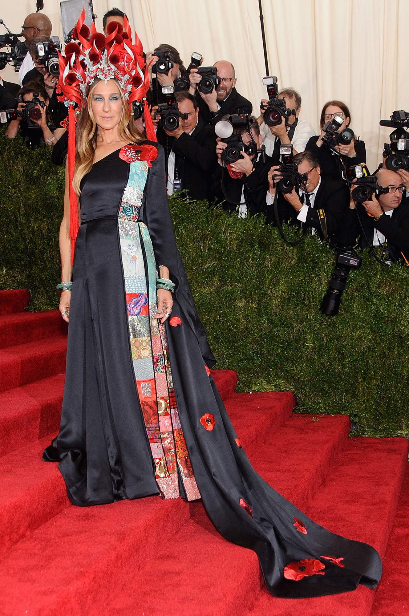 """Happy Birthday, Sarah Jessica Parker! See Her Red Carpet Style Evolution - For the 2015 """"China: Through The Looking Glass""""-themed Met Gala, the fashionista owned the red carpet in her bespoke H&M gown and fiery Philip Treacy headpiece."""