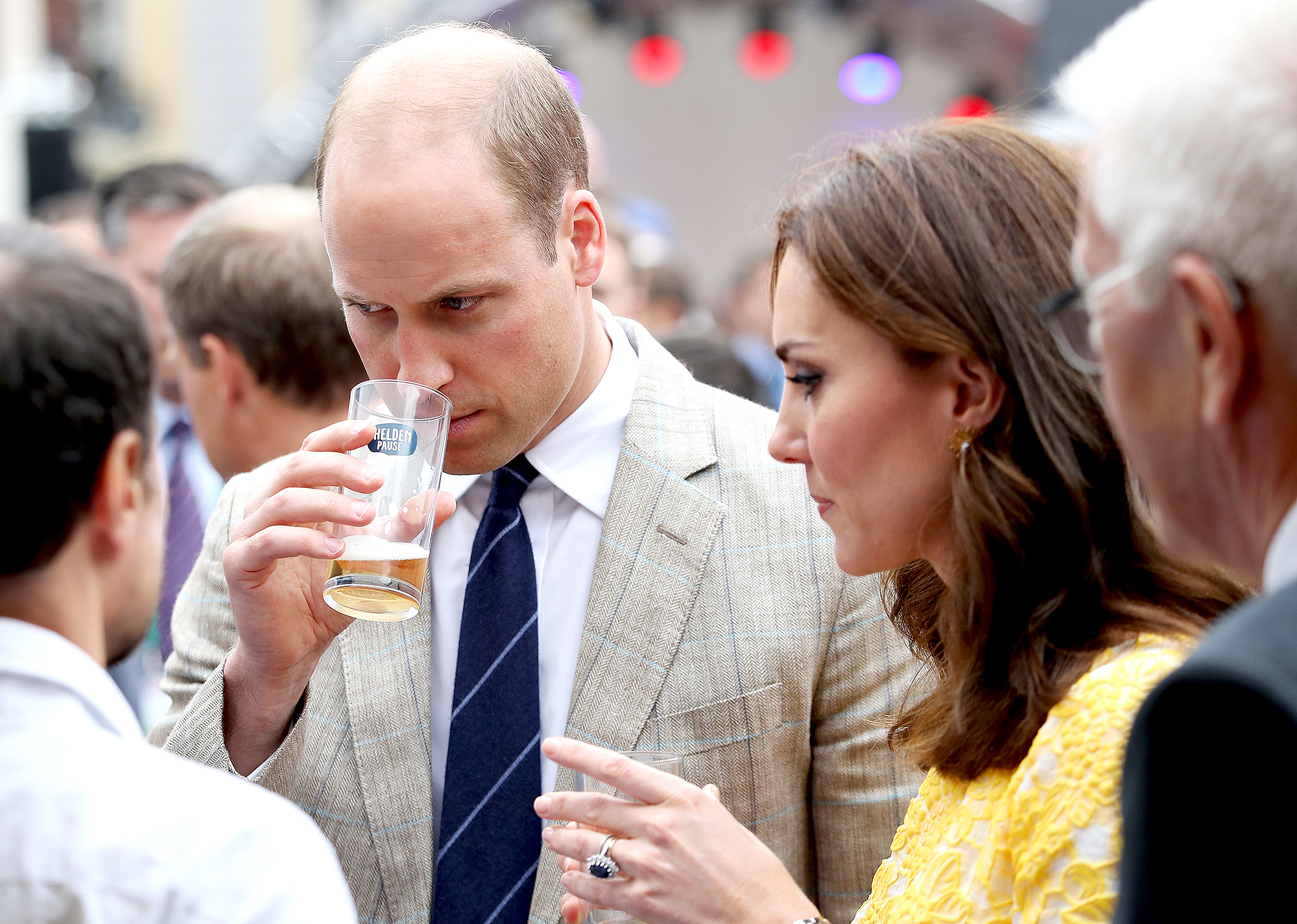 Taking-a-Sniff-prince-william-kate-beer - Ever the curious drinker, the future king of England took a sniff of his beer as Kate looked on during a tour of a traditional German market in Heidelberg, Germany, on July 20, 2017.