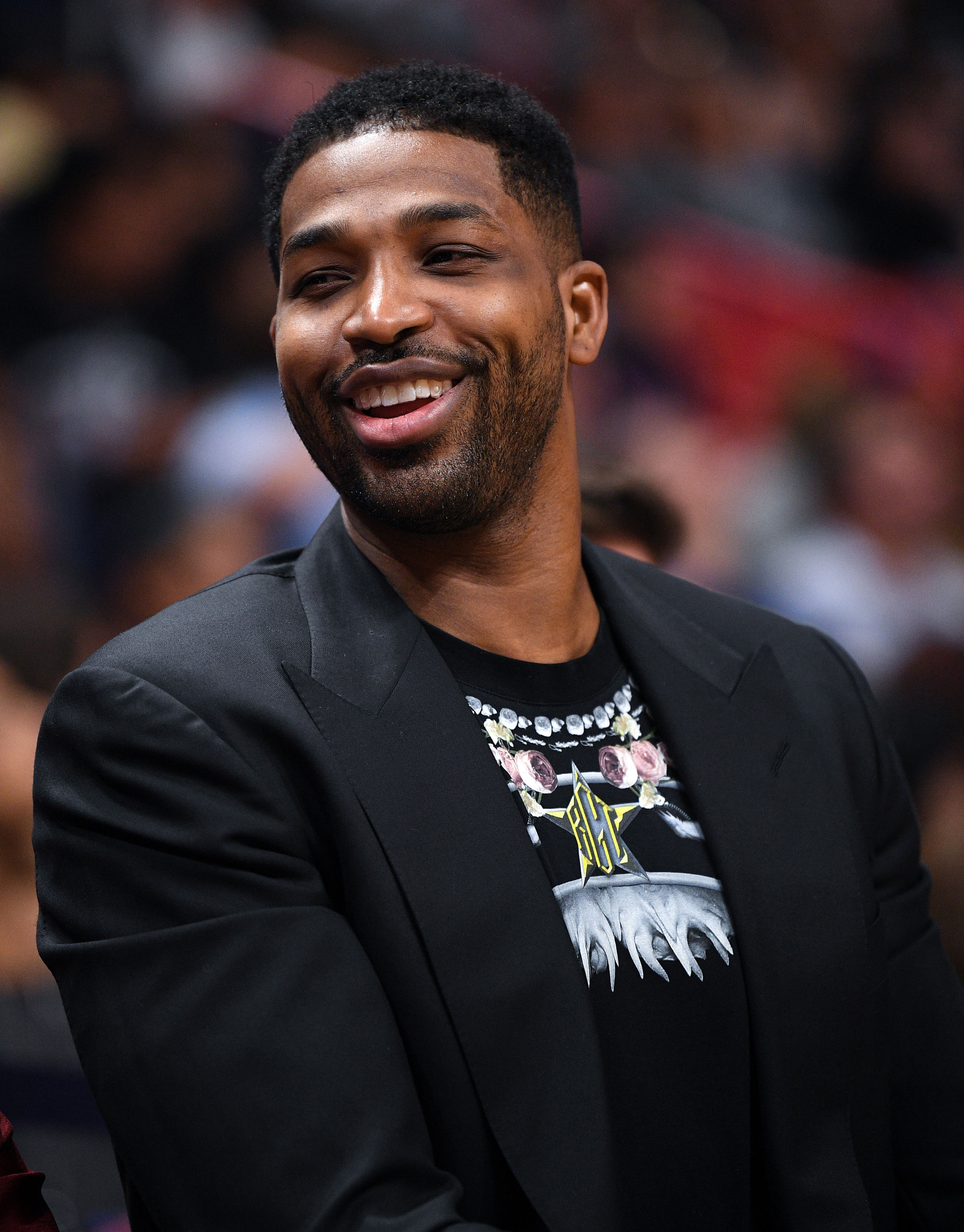 """Tristan Thompson All Smiles at Cavaliers Game in Miami: Pics - """"[Khloé] is never going to take True away from Tristan as long as he's a good father to True and [does] his part. Khloé will always allow Tristan to be in True's life as much as he can be,"""" a source told Us earlier this month. """"She's not a bitter or petty person. Khloé wants a healthy environment for True."""""""