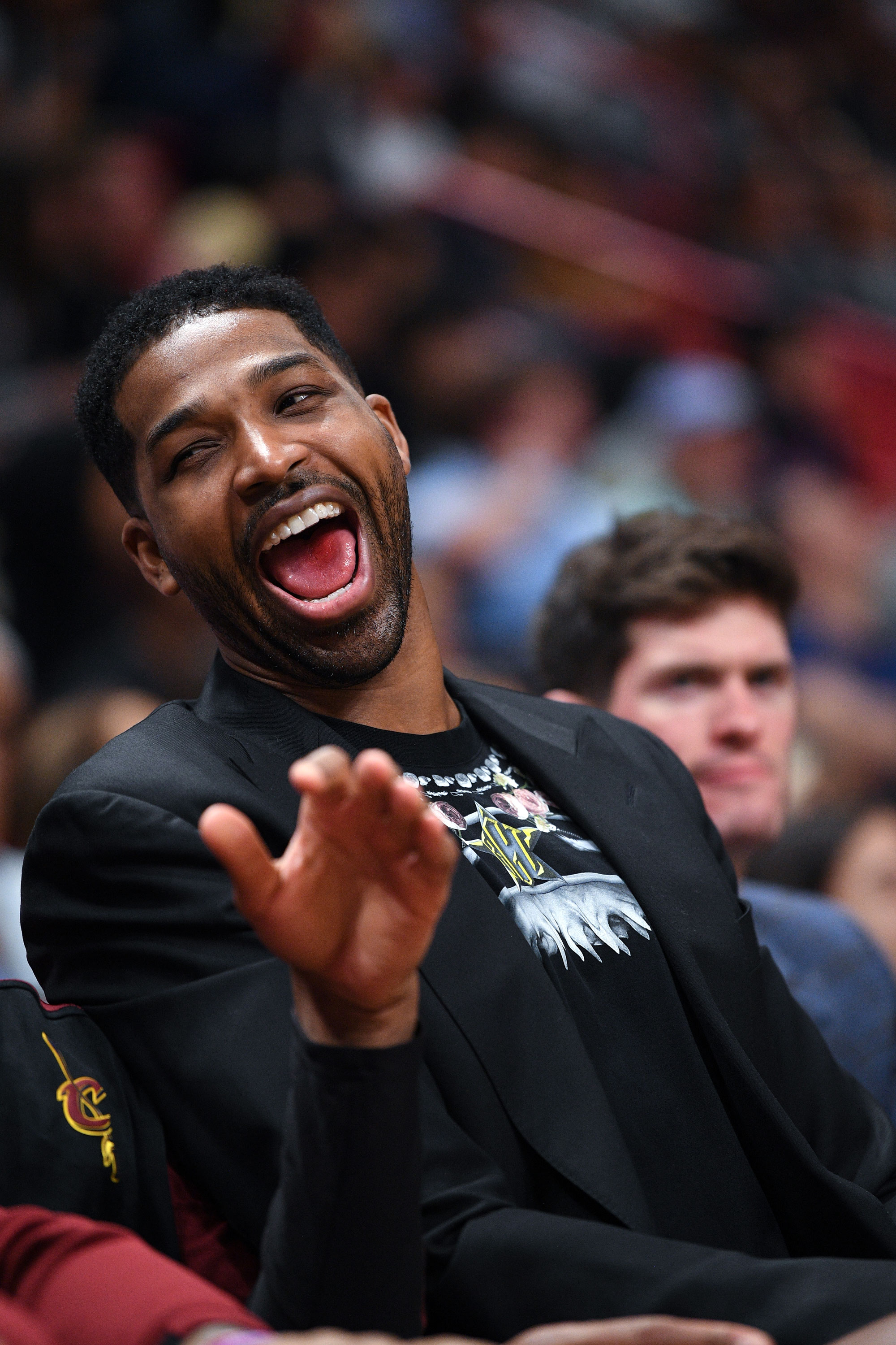 """Tristan Thompson All Smiles at Cavaliers Game in Miami: Pics - An insider revealed to Us in February that Woods """"assumed [the infidelity] was going to blow over."""" She was inspired to apologize on Red Table Talk after the """"public outcry."""""""