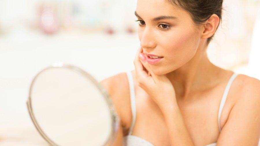 Woman Checking Skin