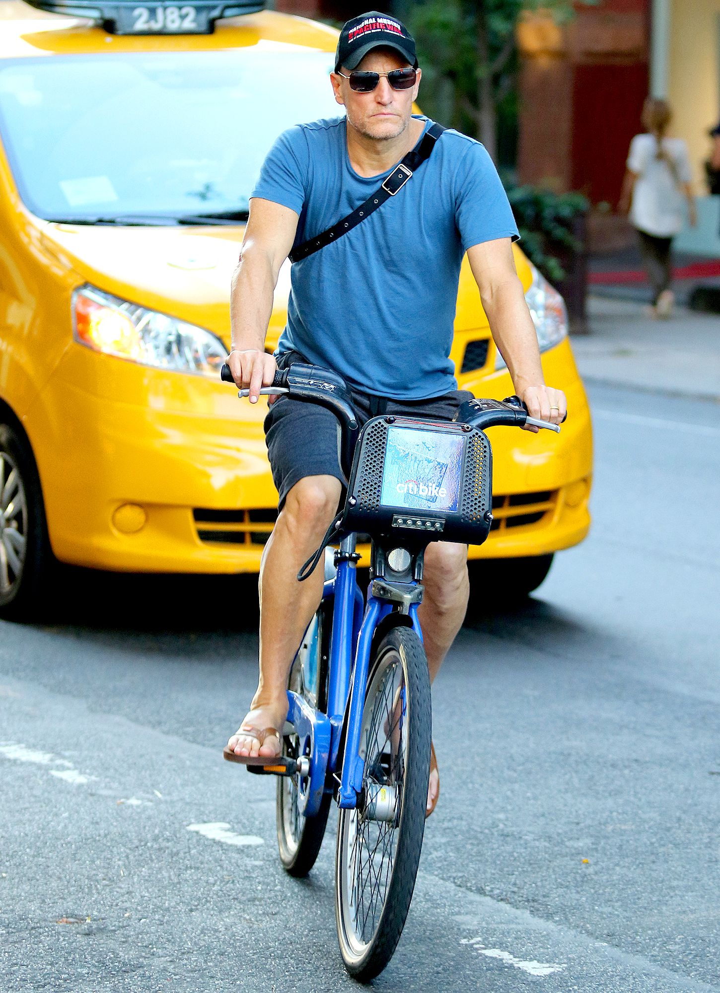 Woody-Harrelson-biking - On October 10, 2018, the actor — wearing flip-flops and a messenger bag slung around his back — used a Citi Bike to get through downtown Manhattan.