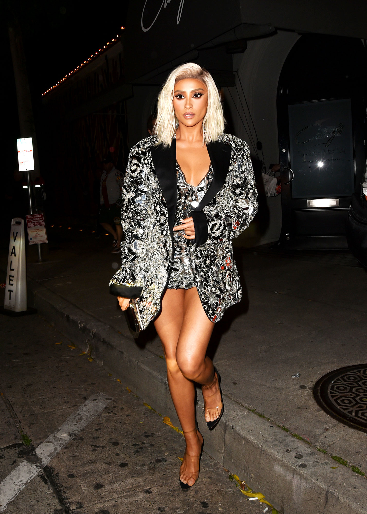 Shay Mitchell about last night - Was seen on the streets of Los Angeles after the iHeart Music Awards in a metallic sequin Nicolas Jebran dress and jacket, and Julien Macdonald shoes, Thursday, March 14.