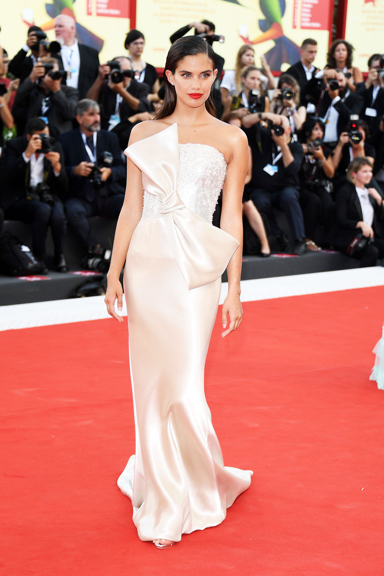 Sara Sampaio Bows red carpet gallery for Stylish - In a lamé silk Armani Privé on Aug. 29.