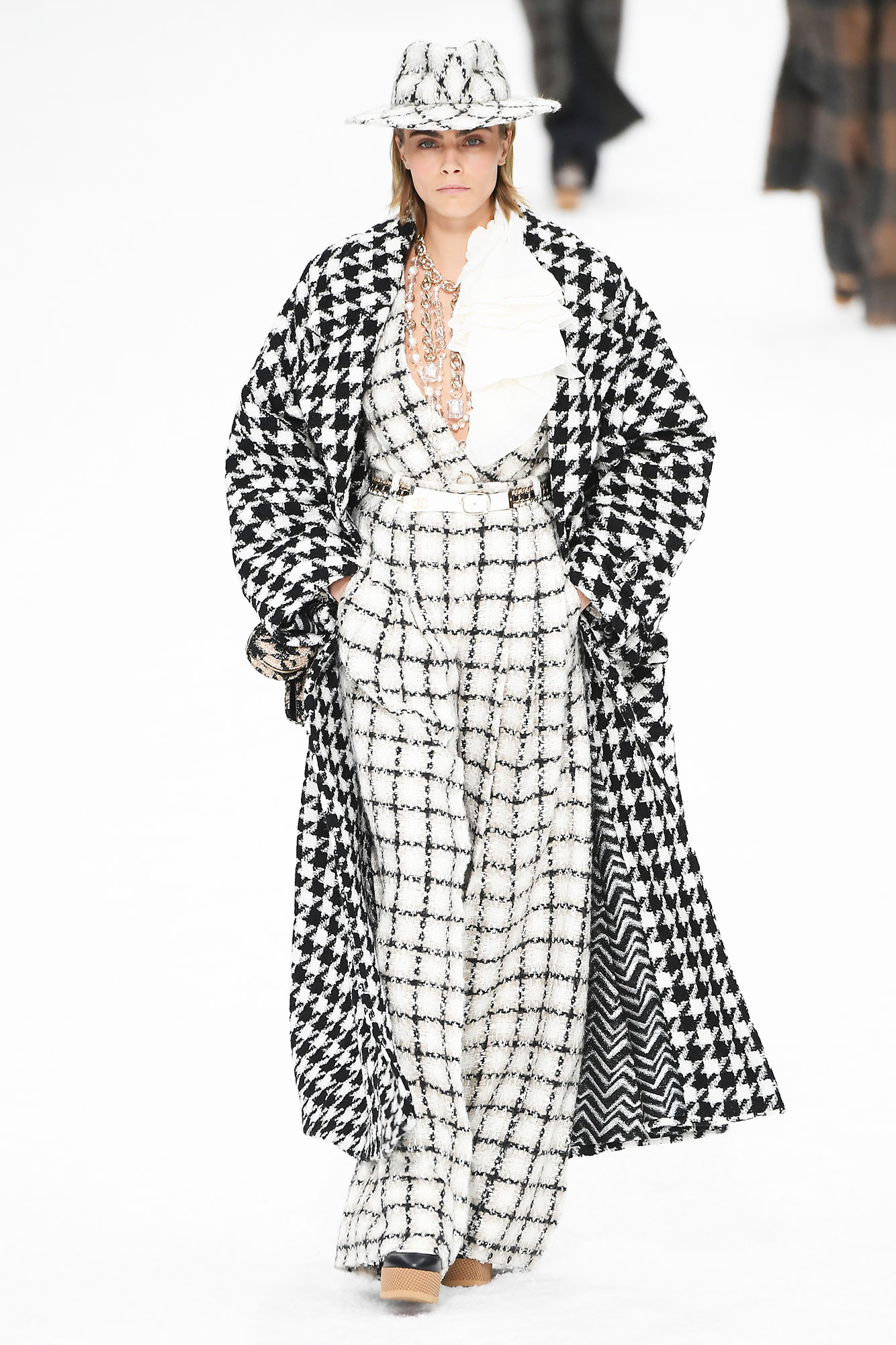 Karl Lagerfeld's Final Runway Was a Star-Studded Tribute to the Late Designer - To kick off the show, the British beauty wore a wide-leg checkered jumpsuit with a matching hat and houndstooth coat, all in shades of black and white.