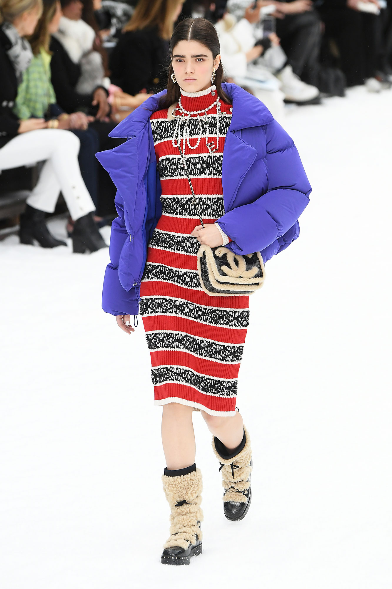 Karl Lagerfeld's Final Runway Was a Star-Studded Tribute to the Late Designer - Adding a splash of color to the affair, this stripped knee-length dress surprisingly works with the purple puffer jacket and furry snow boots.