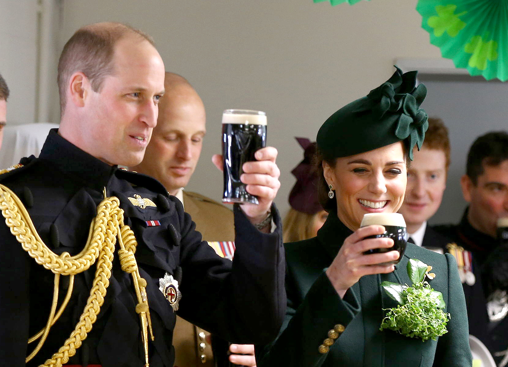 duchess-kate-prince-william-beer - The royal pair met with Irish Guards and toasted with pints of Guinness after attending the St. Patrick's Day parade at Cavalry Barracks in Hounslow, England, on March 17, 2019.