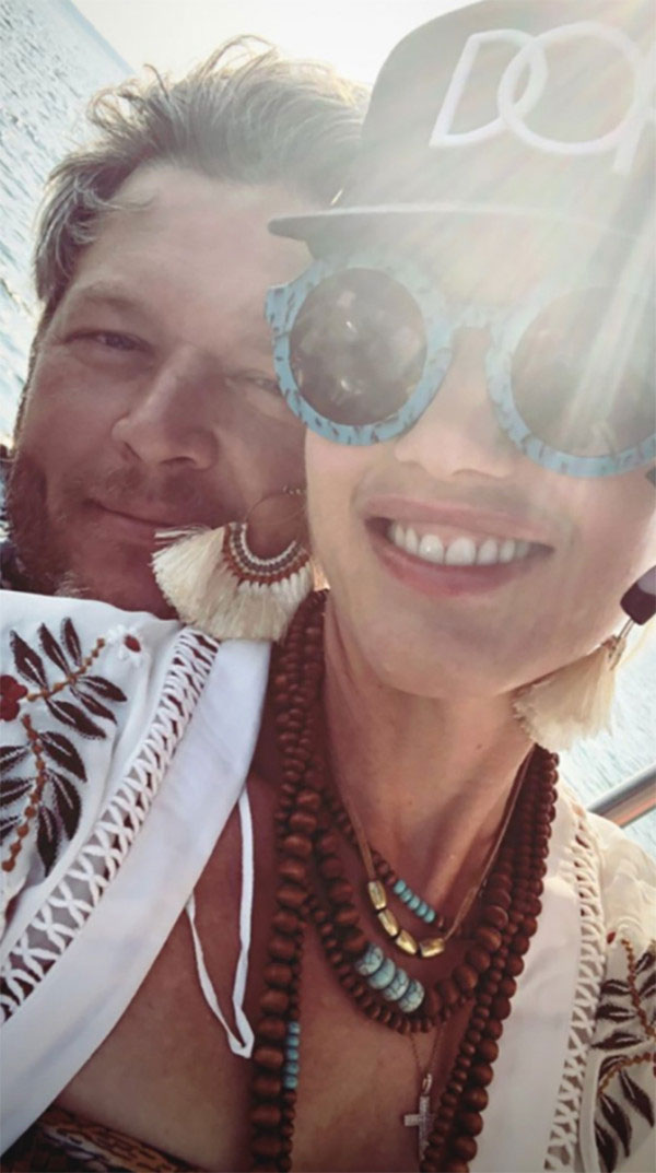 Gwen-Stefani-blake-shelton-sweetest - The duo cuddled up again one month later while vacationing in Shelton's native Oklahoma with Stefani's brood. The pair, who also vacationed in Antigua earlier in 2018 according to a source, were all smiles while snuggling on a boat during the trip.