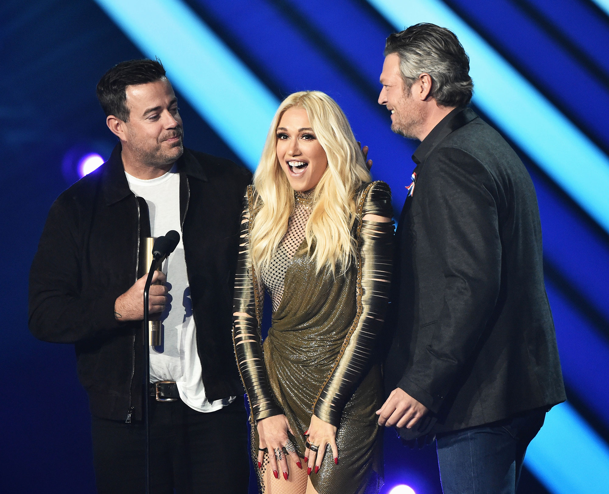 "Gwen-Stefani-blake-shelton-sweetest - Stefani and Shelton were so lovey dovey at the 2018 People's Choice Awards , that Voice host Carson Daly told the crowd the twosome were going to "" get a room ."""