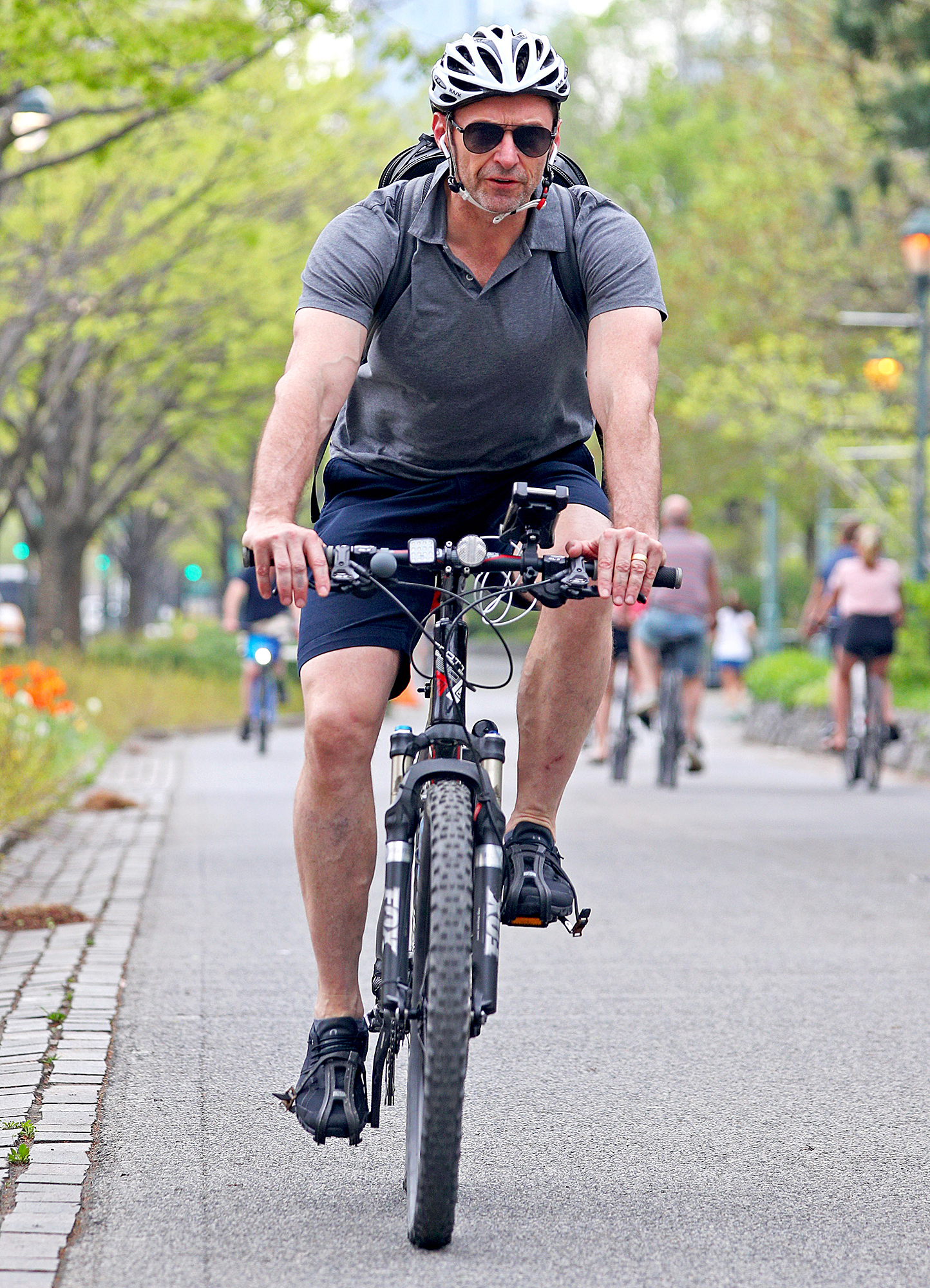 hugh-jackman-biking - With his head wisely protected by a helmet, Wolverine weaved through pedestrians in NYC on May 4, 2018.