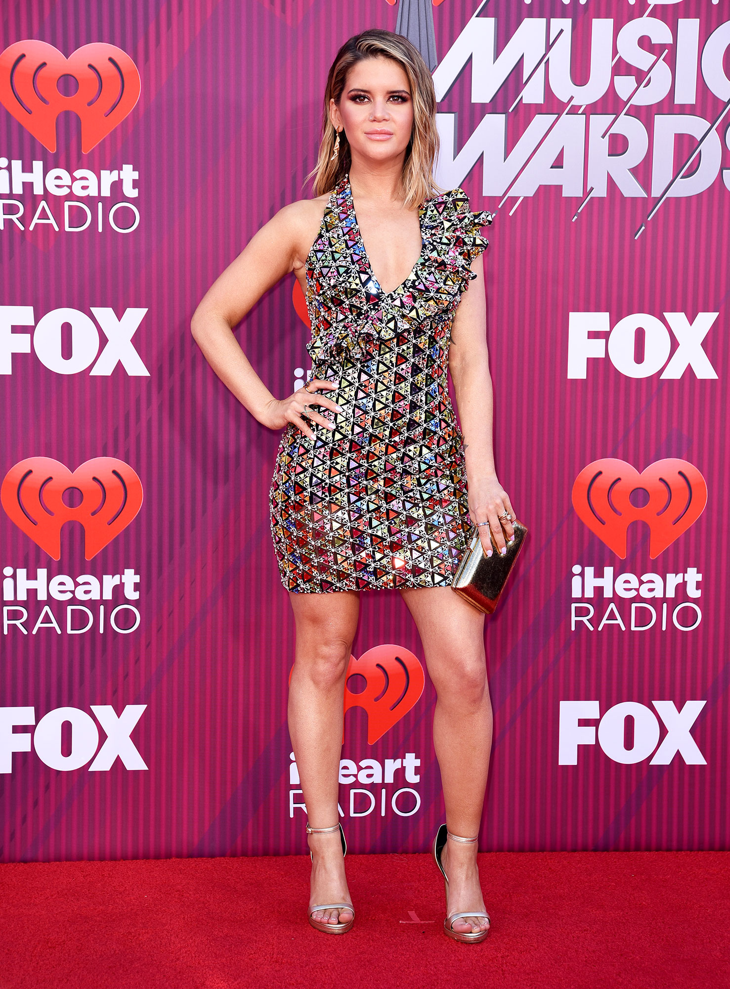 Maren Morris See What the Stars Wore to the iHeart Radio Music Awards 2019 - Wearing a colorful Rami Kadi mini and Versace heels.