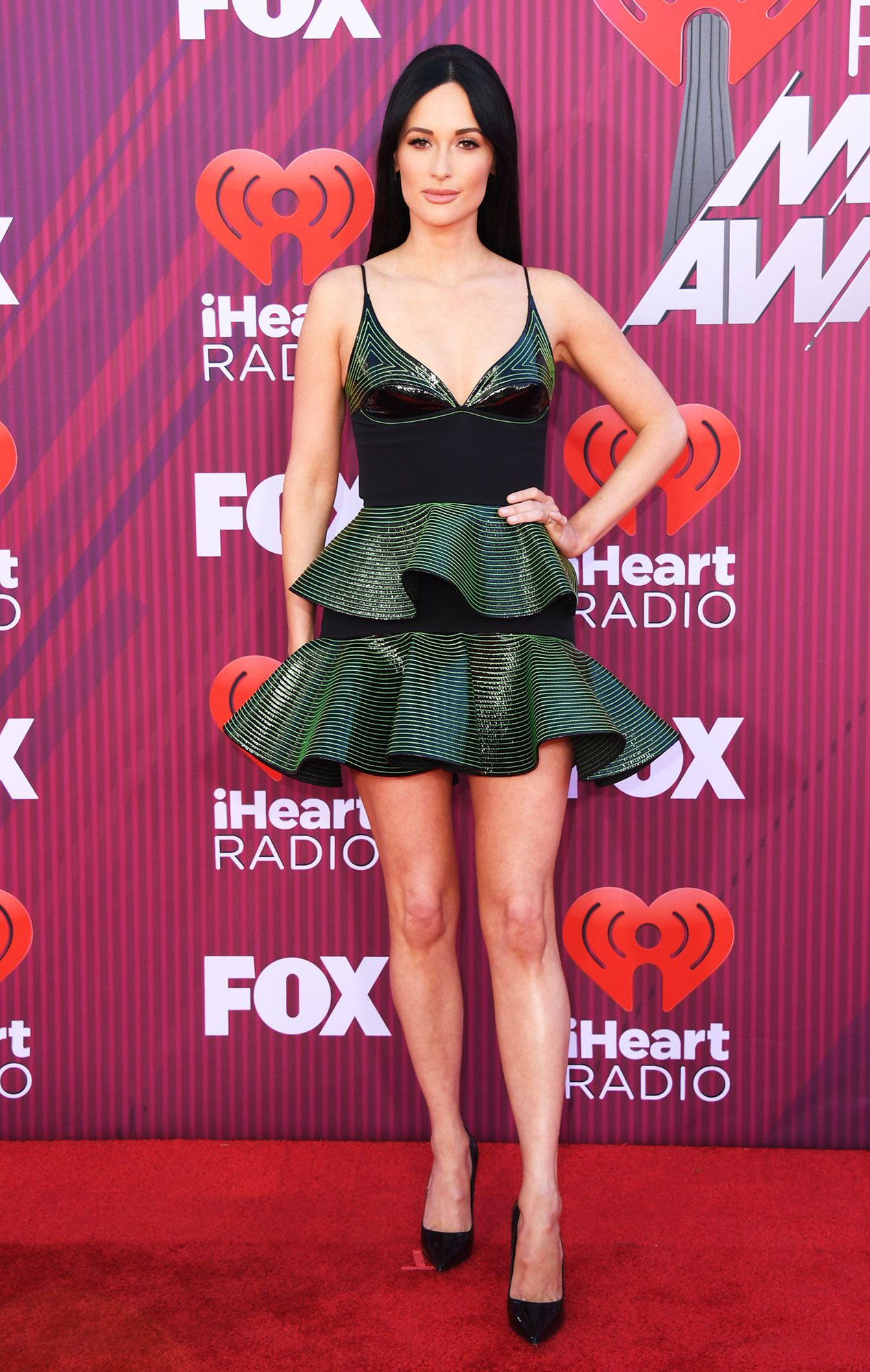 Kacey Musgraves See What the Stars Wore to the iHeart Radio Music Awards 2019 - Wearing a tiered David Koma mini with Graziela Gems and EFFY Jewelry bling.