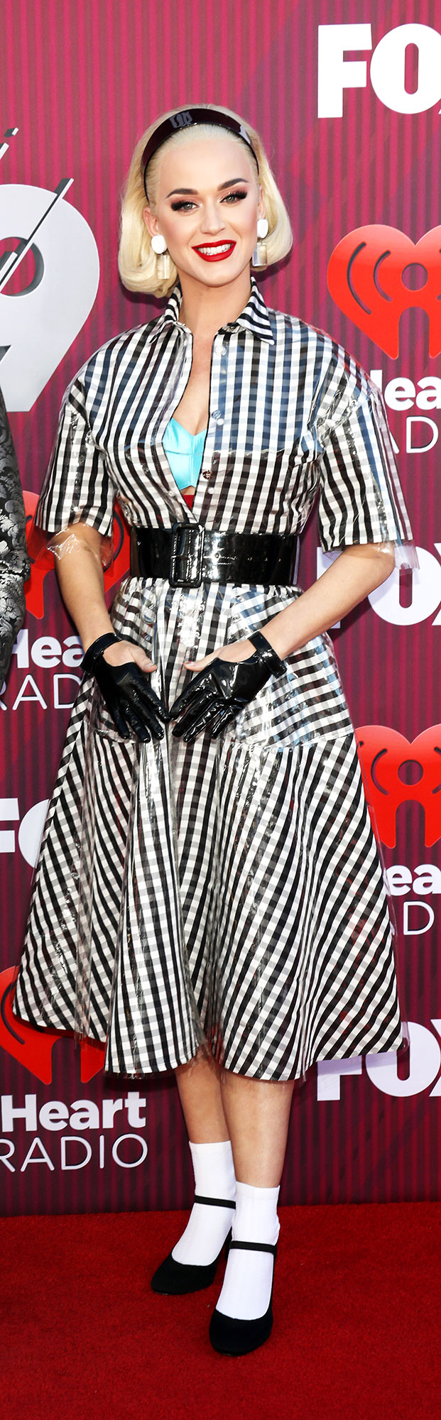 Katy Perry See What the Stars Wore to the iHeart Radio Music Awards 2019 - Wearing a black and white gingham mididress with a bright blue bra.