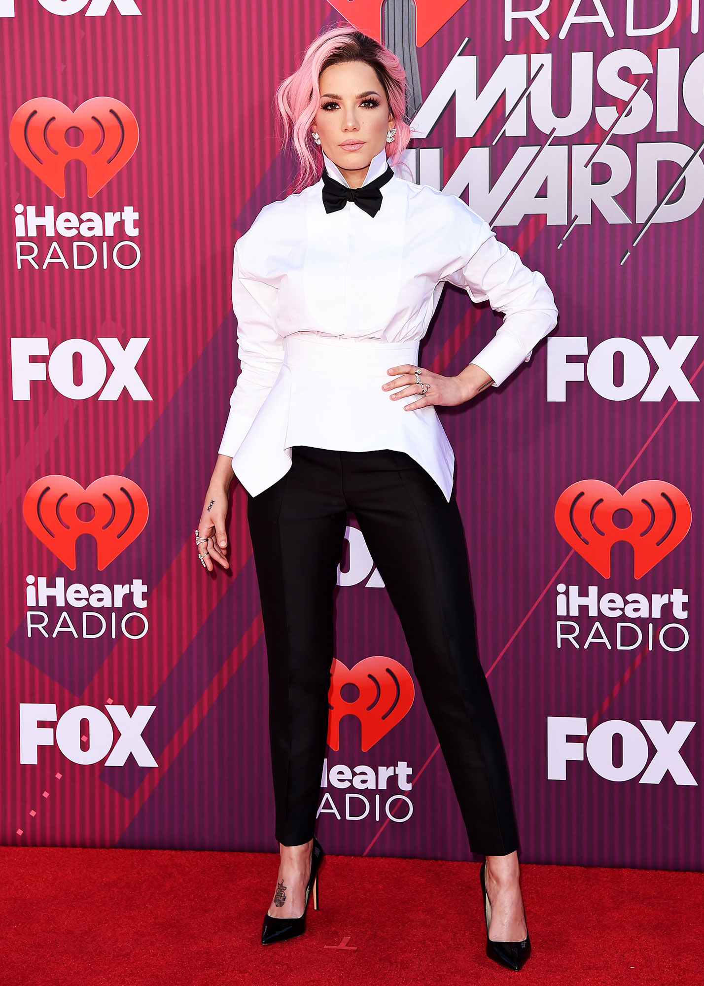 Halsey See What the Stars Wore to the iHeart Radio Music Awards 2019 - Wearing a DSQUARED2 suit, Anita Ko jewelry and Cult Of Coquette shoes.
